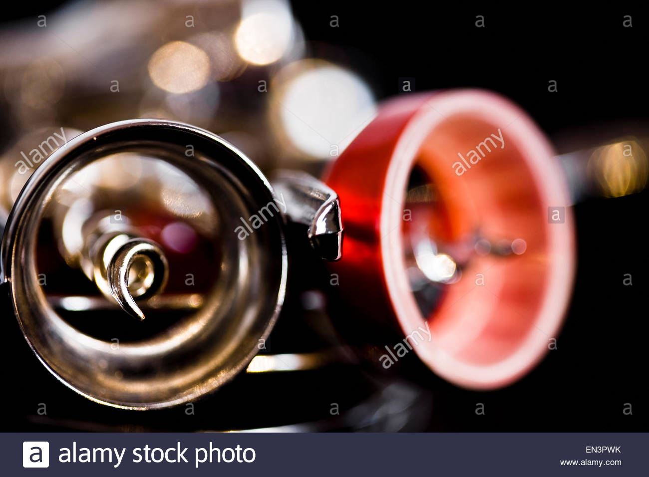 Close-up of corkscrews with highlights on dark background - Stock Image
