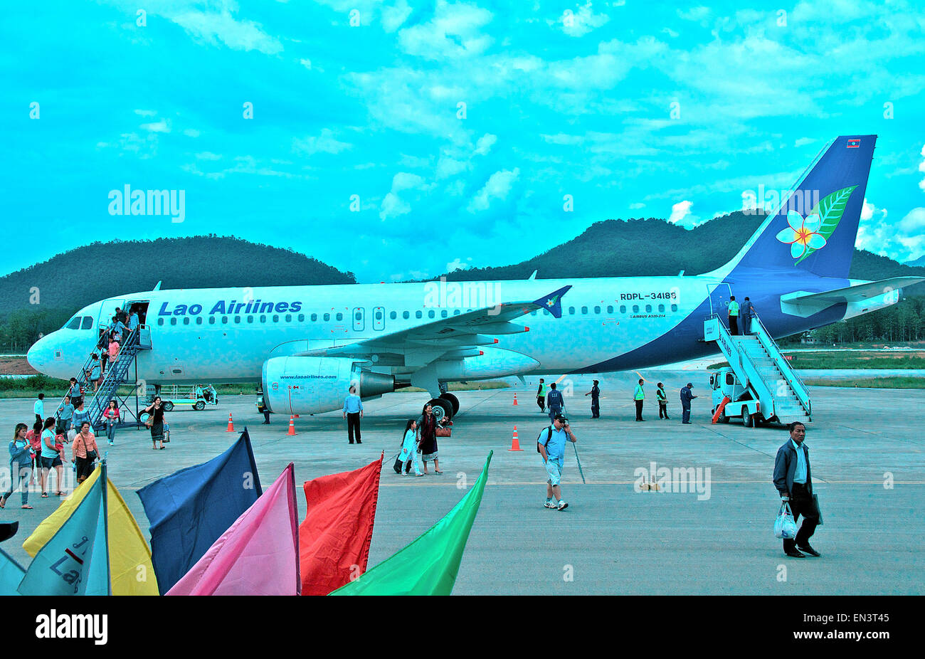 passengers leaving an Airbus A320-214 of Lao airlines Luang Prabang airport Laos - Stock Image
