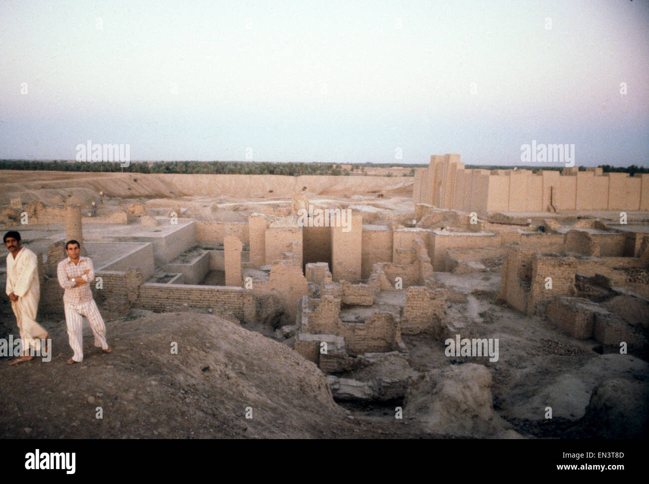 Two men on the walls of the ancient Sumerian city of Babylon in Iraq Stock Photo