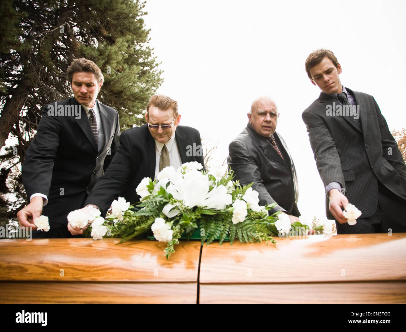 People at a funeral in a cemetery stock photo 81834384 alamy people at a funeral in a cemetery izmirmasajfo