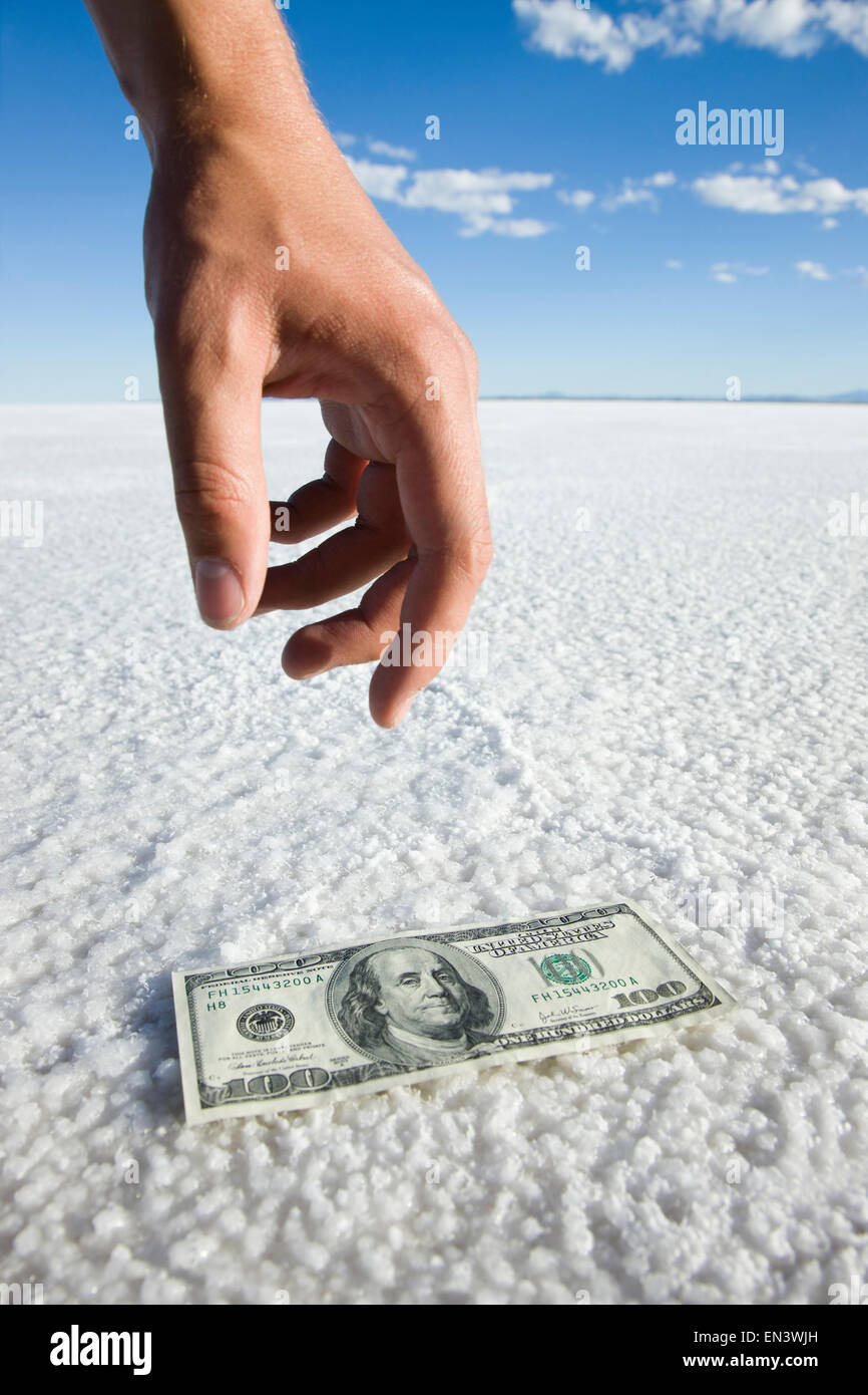 one hundred dollar bill in the middle of nowhere - Stock Image