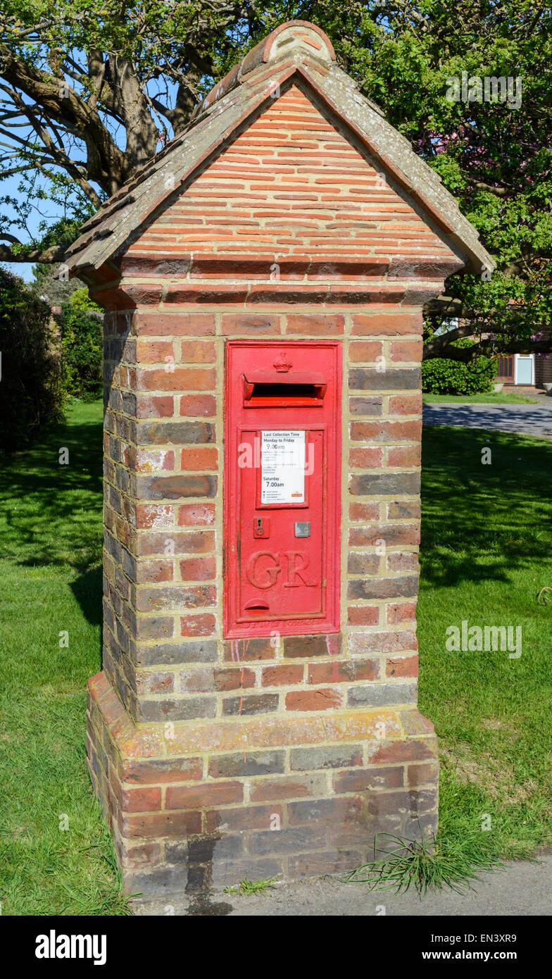 Royal Mail postbox set into a brick pillar, in England, UK. - Stock Image