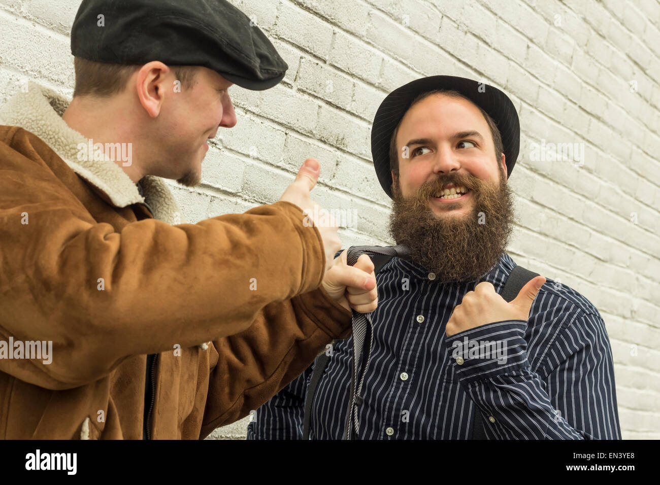 Two silly enemies great through clenched teeth - Stock Image
