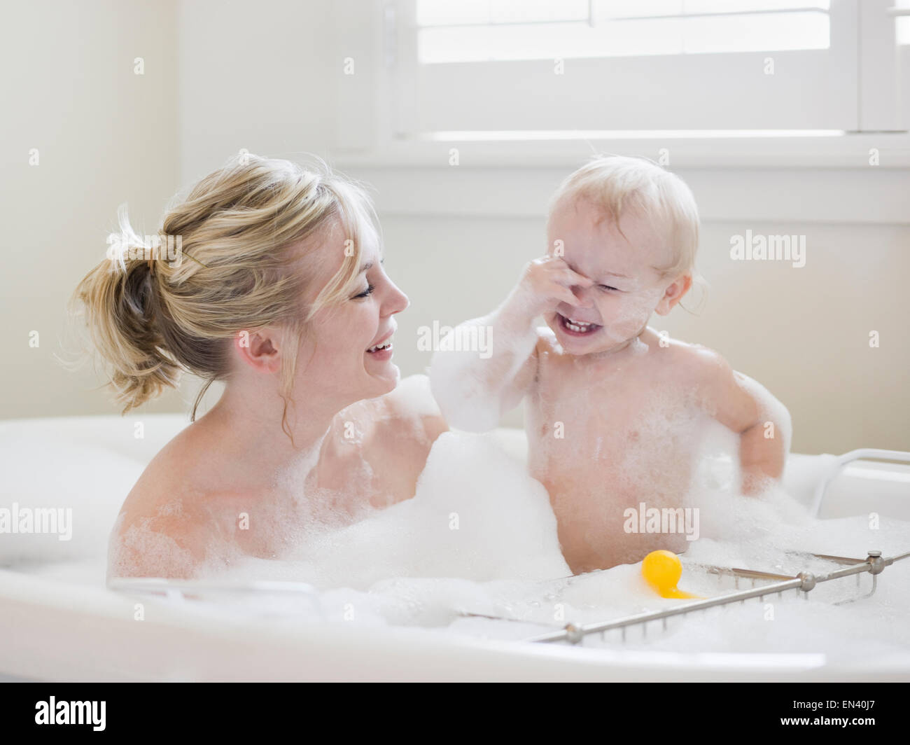 Mother And Baby Taking A Bubble Bath Stock Photo 81837567