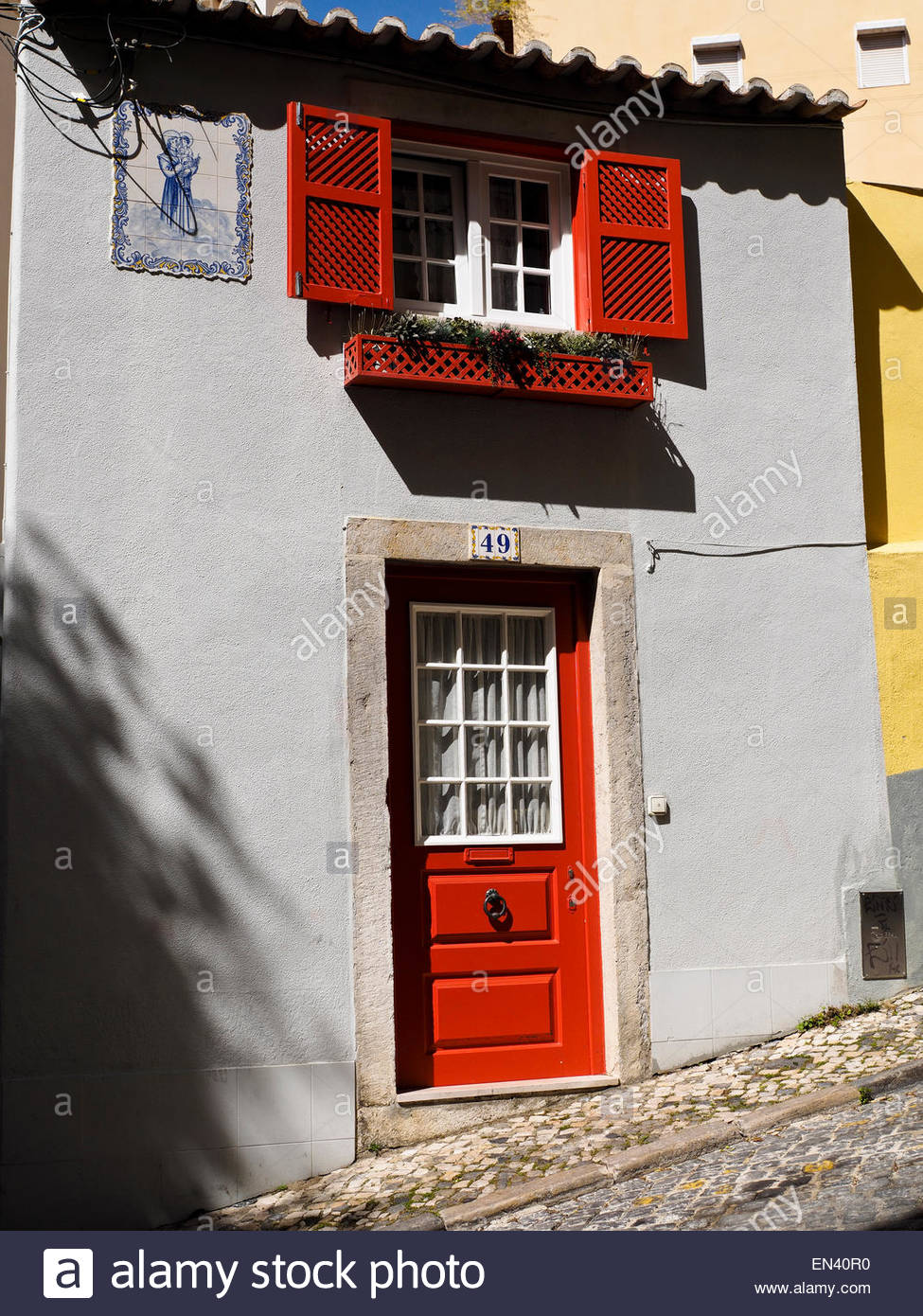 Red Painted Front Door And Shutters On House In The Bairro Alto