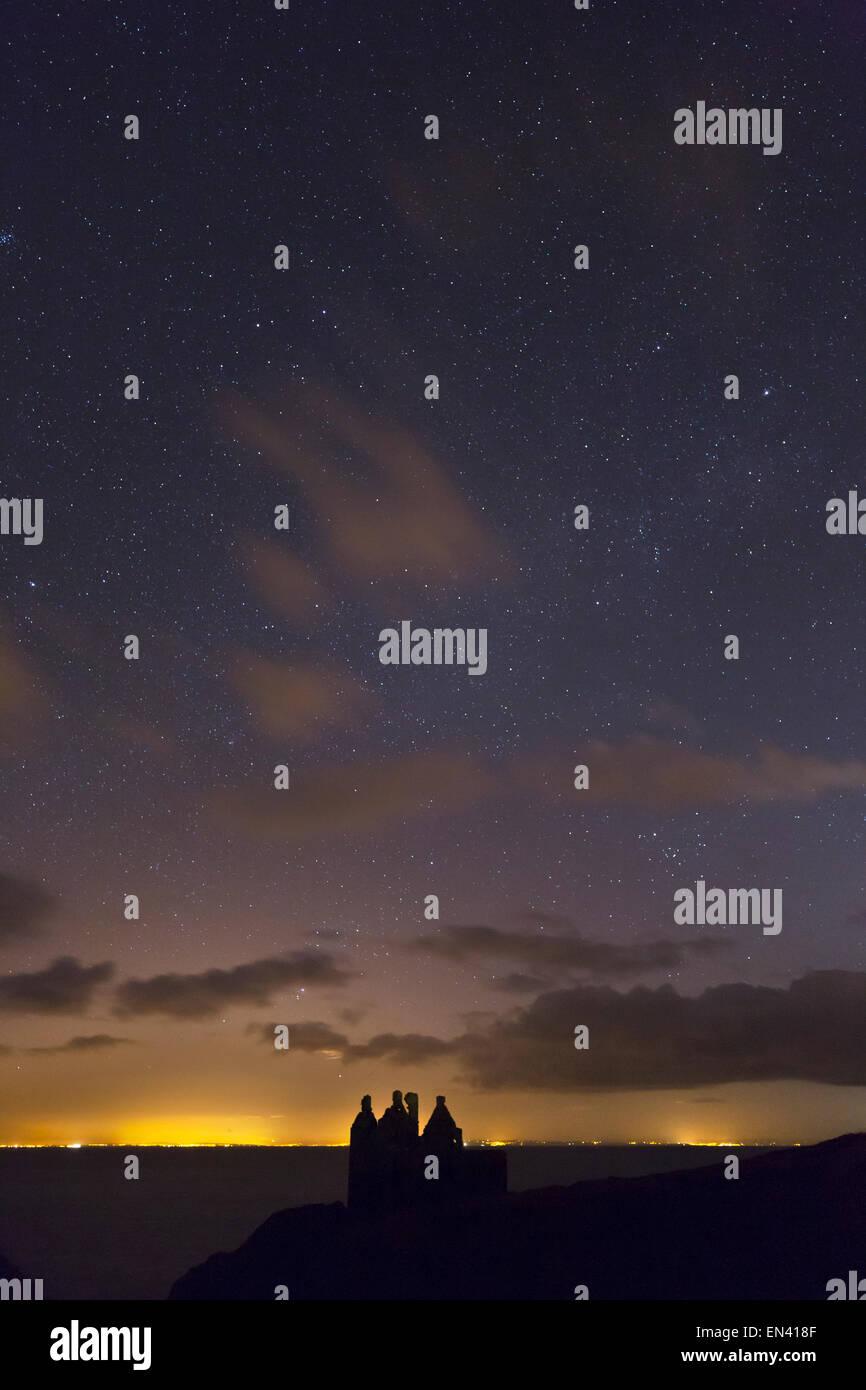 Night sky over Dunskey Castle at Portpatrick, Galloway, Scotland - Stock Image