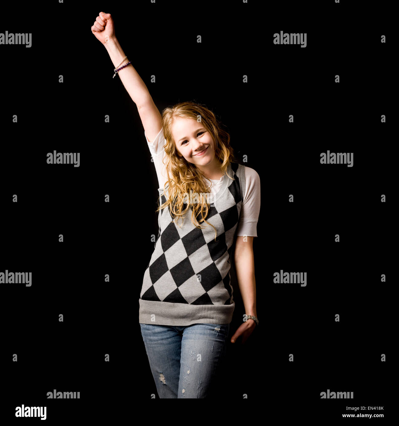 young woman in an argyle sweater vest - Stock Image