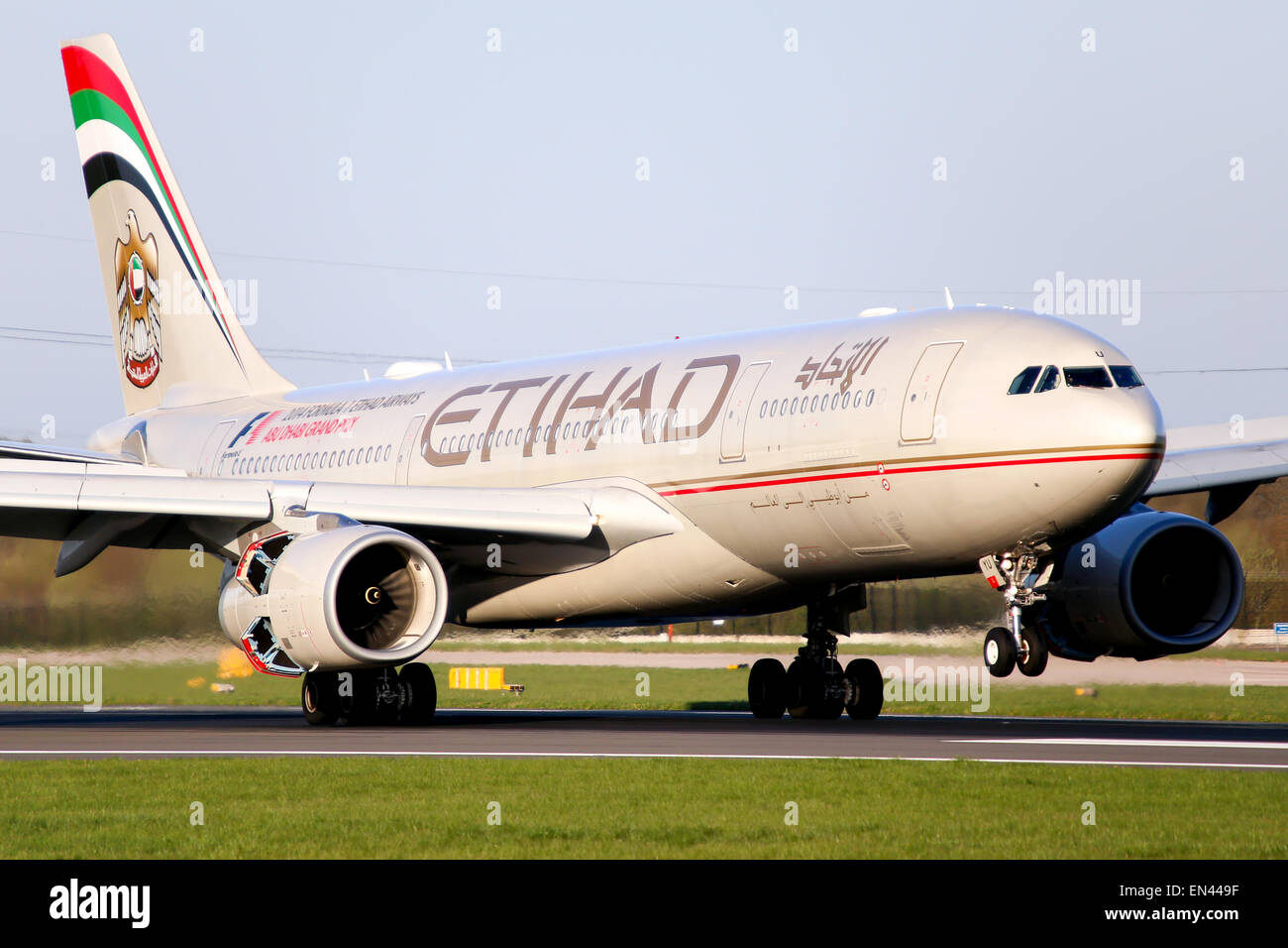 Etihad Airways Airbus A330-200 touches down on runway 05R at Manchester airport. - Stock Image