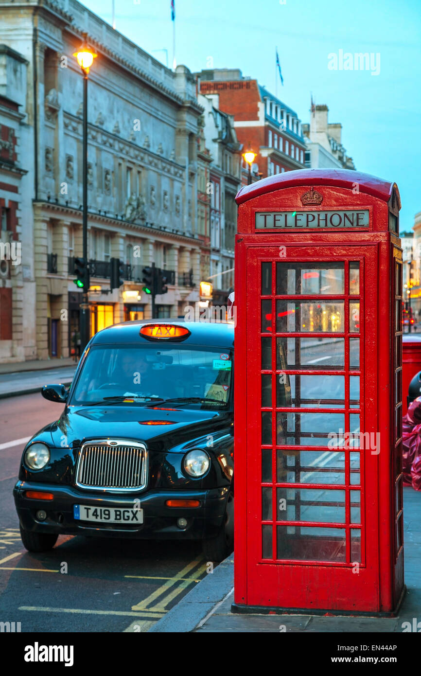 LONDON - APRIL 12: Famous red telephone booth and taxi cab on April 12, 2015 in London, UK. - Stock Image