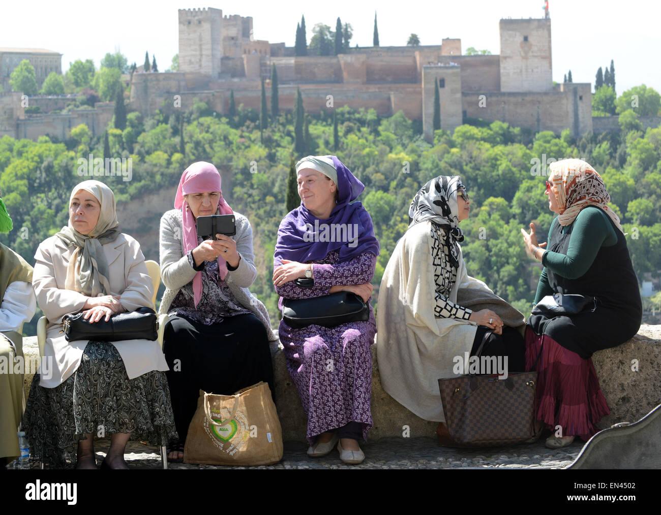 Muslim women females sitting talking in Granada Spain - Stock Image
