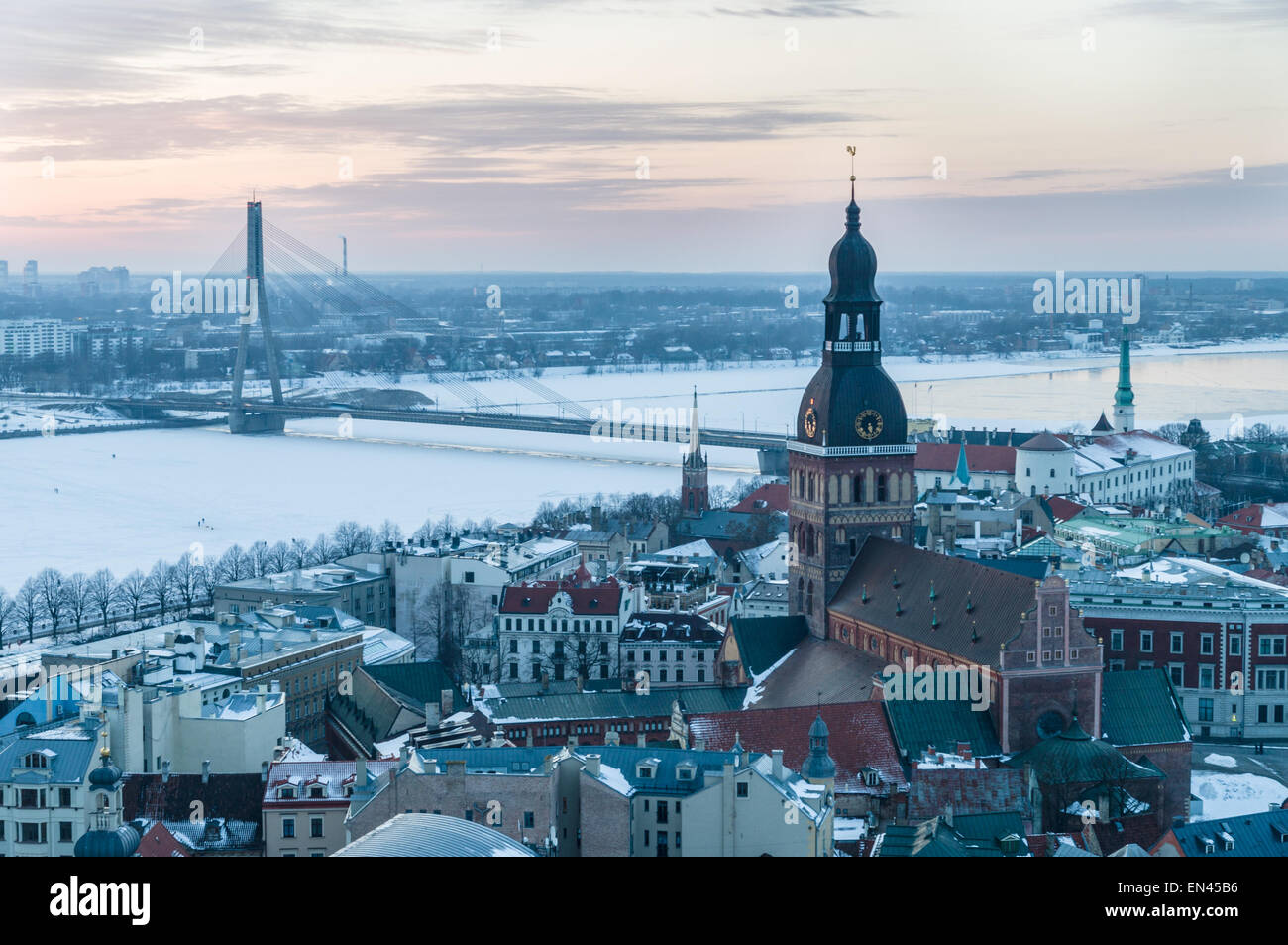 Old and modern Riga winter from viewing platform after sunset, Latvia - Stock Image