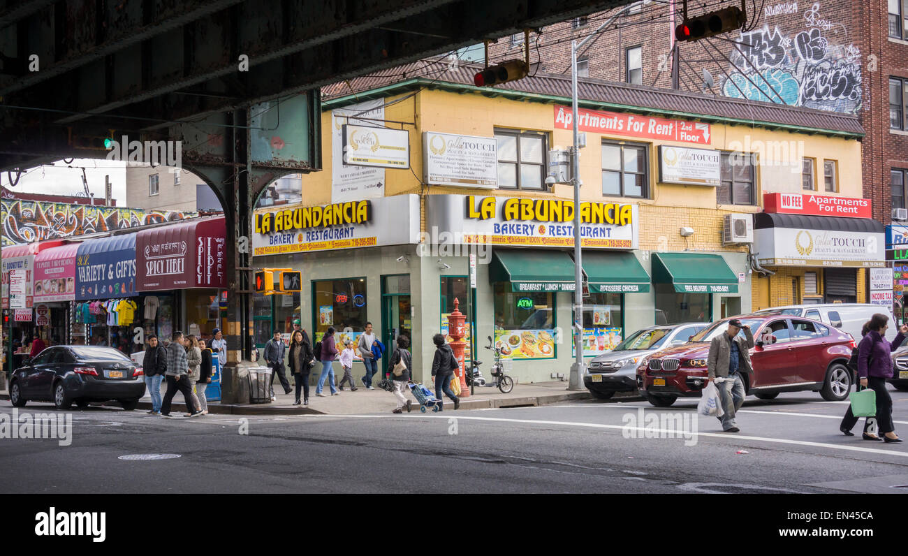 Businesses and activities under the elevated Number 7 train in the Jackson Heights neighborhood in Queens in New - Stock Image