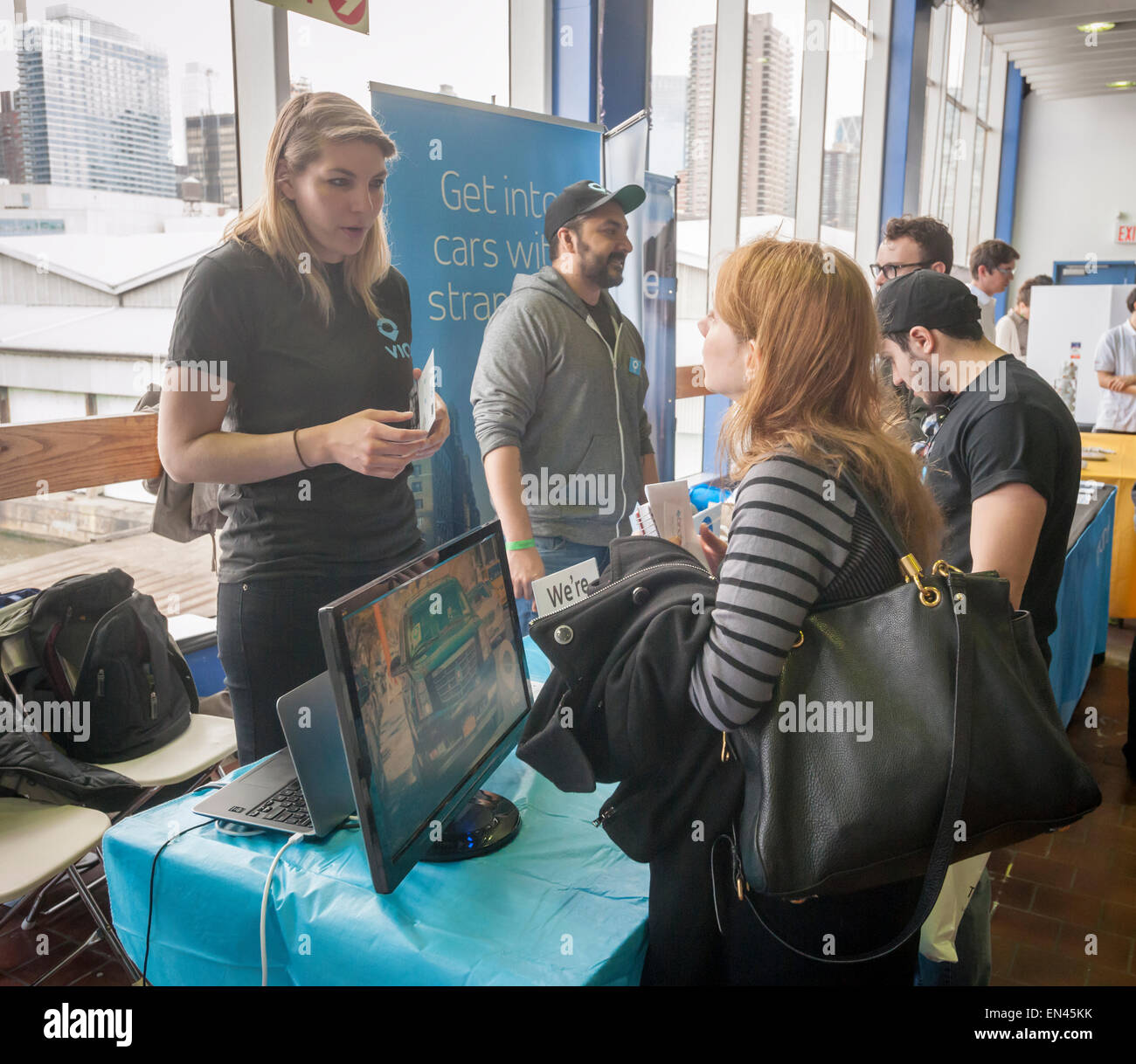 A job seeker speaks with a Via employee at the TechDay New York event on Thursday, April 23, 2015. Thousands attended Stock Photo