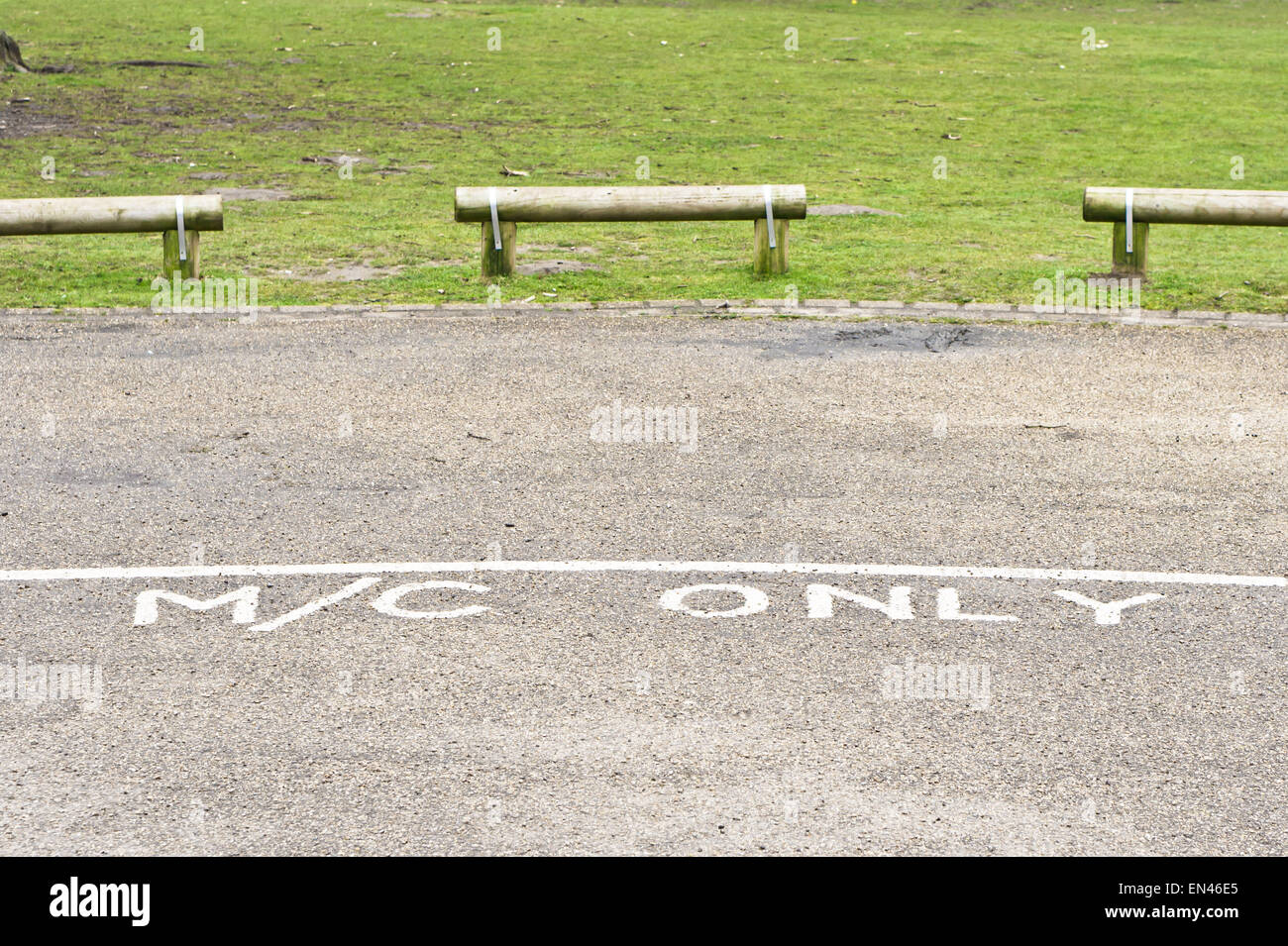 Designated parking area for motorcycles in a public park in the UK Stock Photo