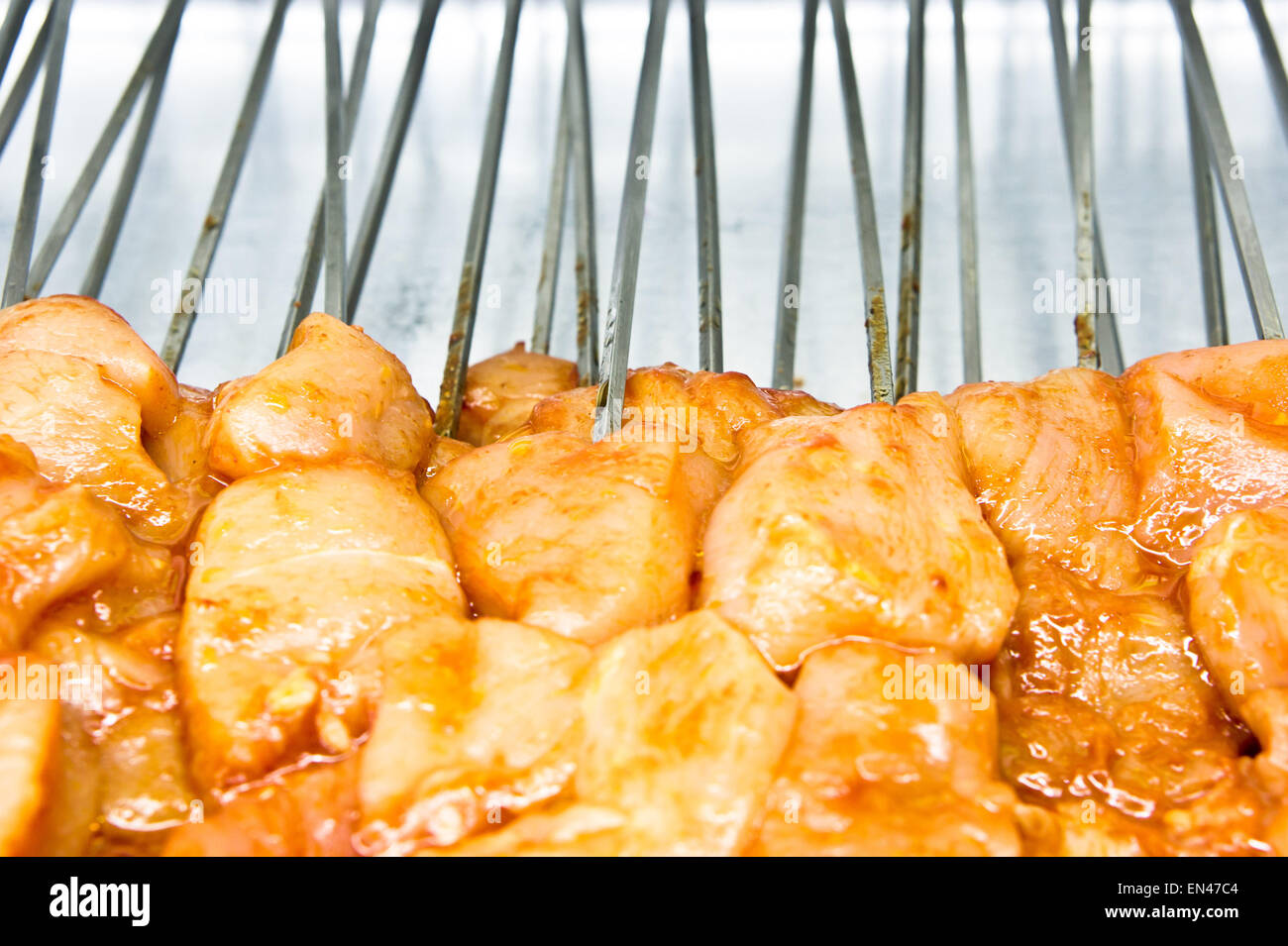 Raw chicken pieces on skewers in a kebab shop Stock Photo