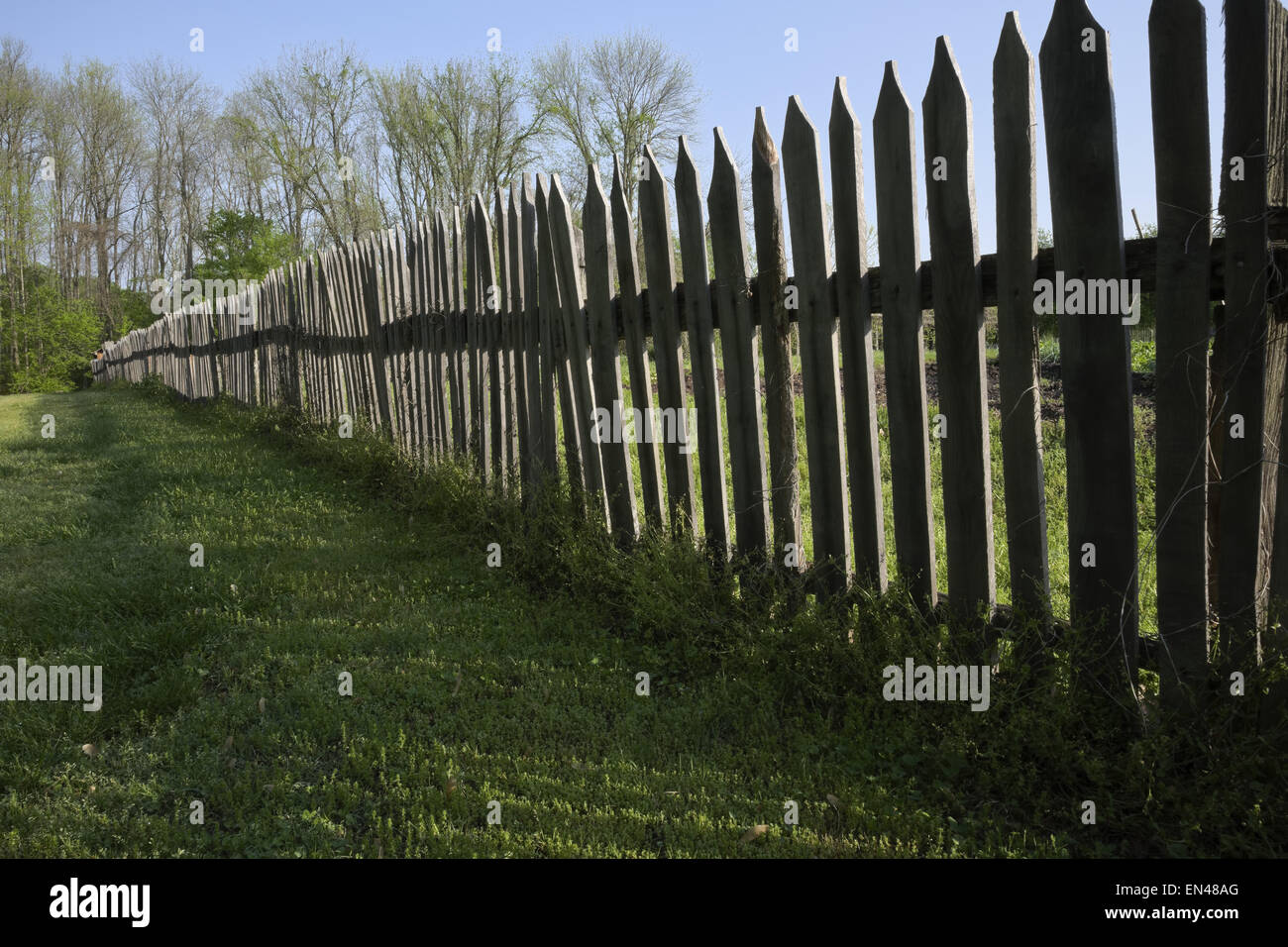 old weathered wooden picket fence - Stock Image