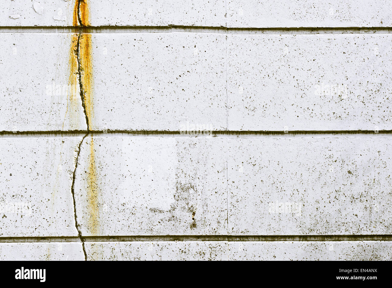 A vertical crack in a stone wall Stock Photo