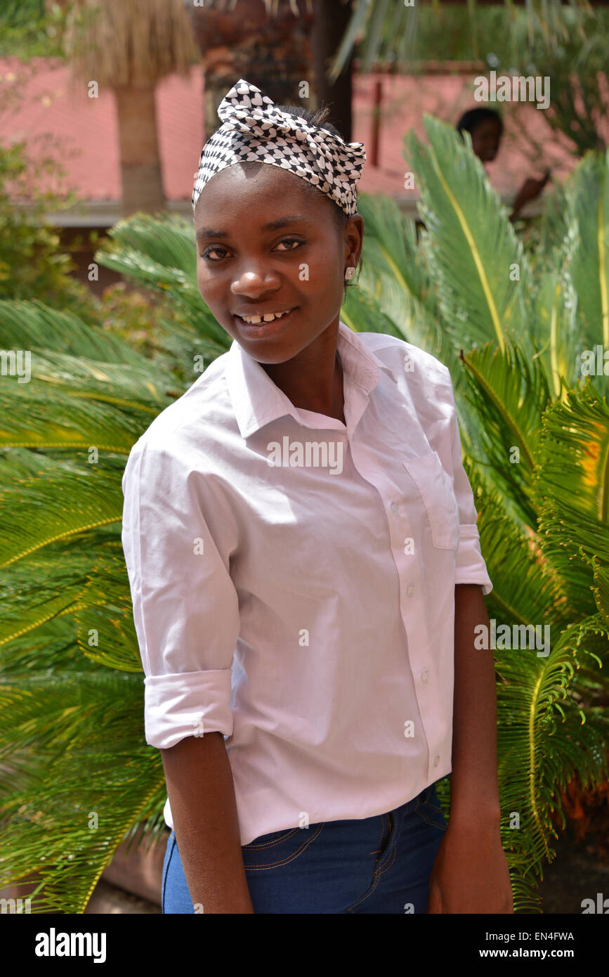 Young female kitchen worker at guest house, Windhoek, Khomas Region, Republic of Namibia - Stock Image