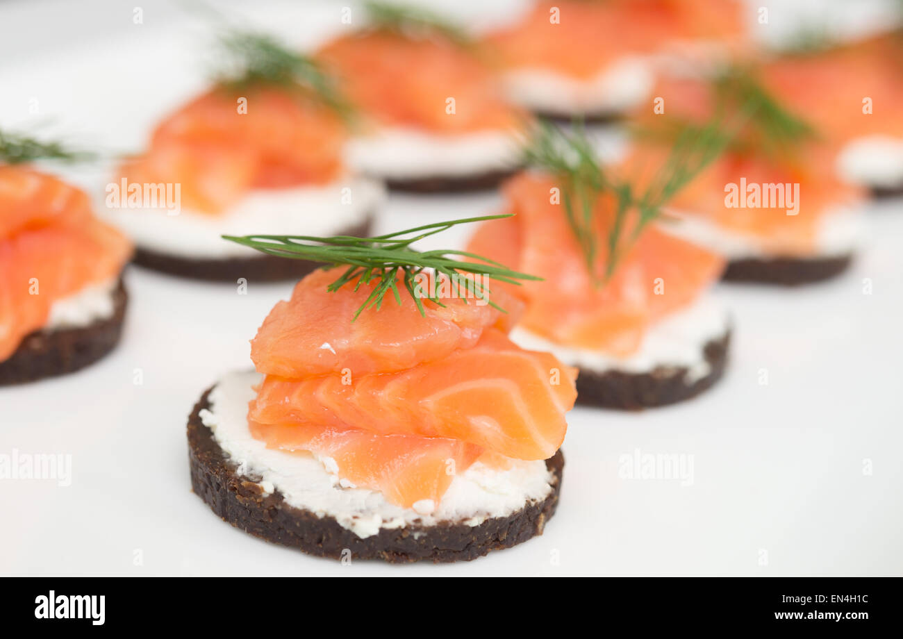 canapes with soft cheese and red fish - Stock Image