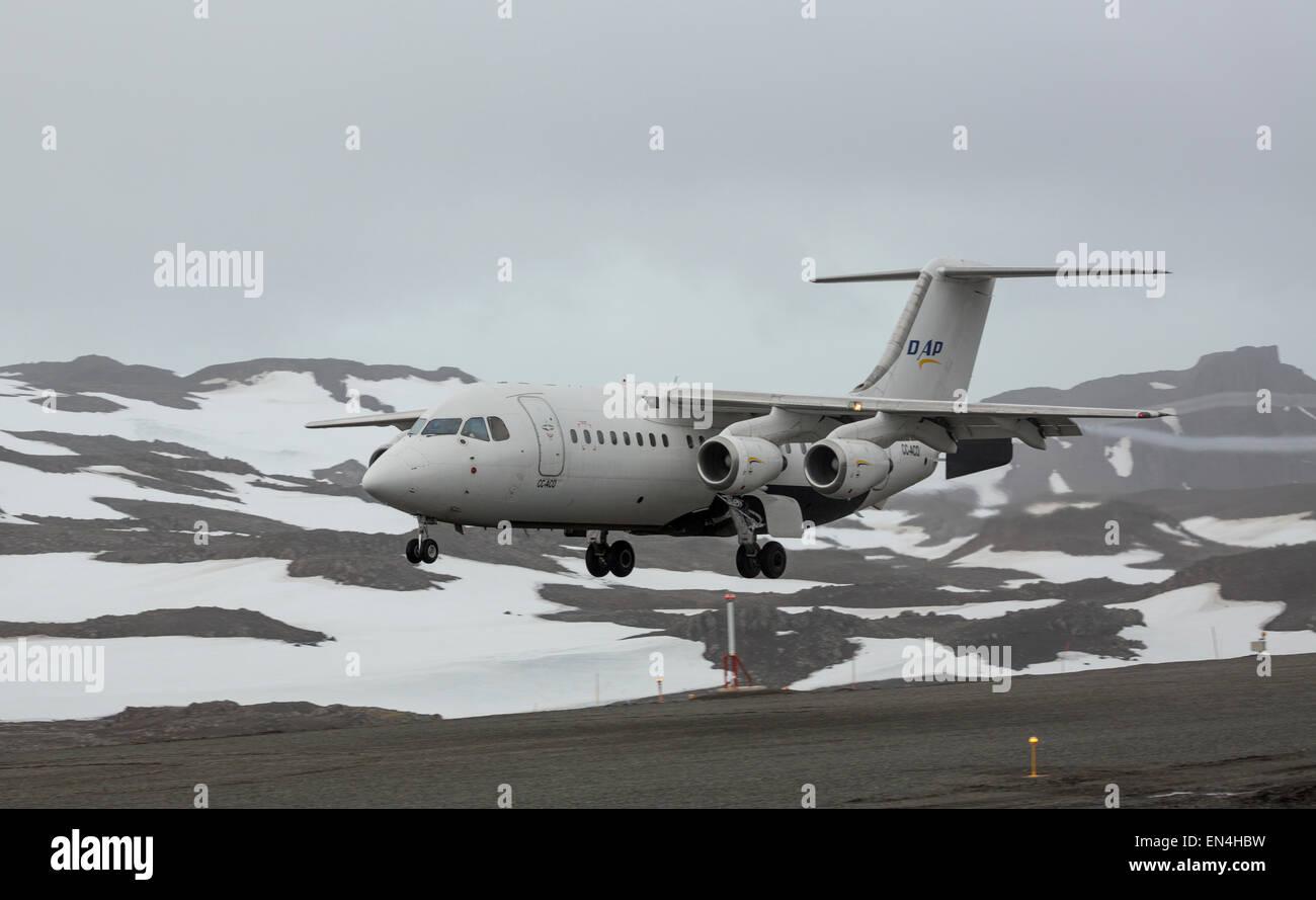BAE 146-200 high wing plane landing at Frei station, King George Island, Antarctica - Stock Image