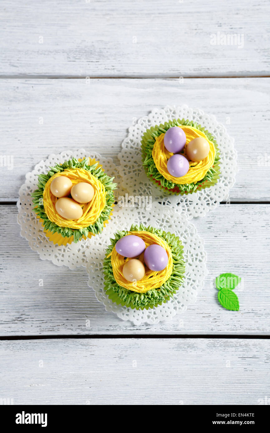 Cupcakes with cream and eggs, dessert - Stock Image