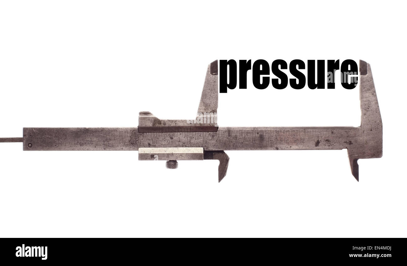 Color horizontal shot of a caliper and measuring the word 'pressure'. - Stock Image