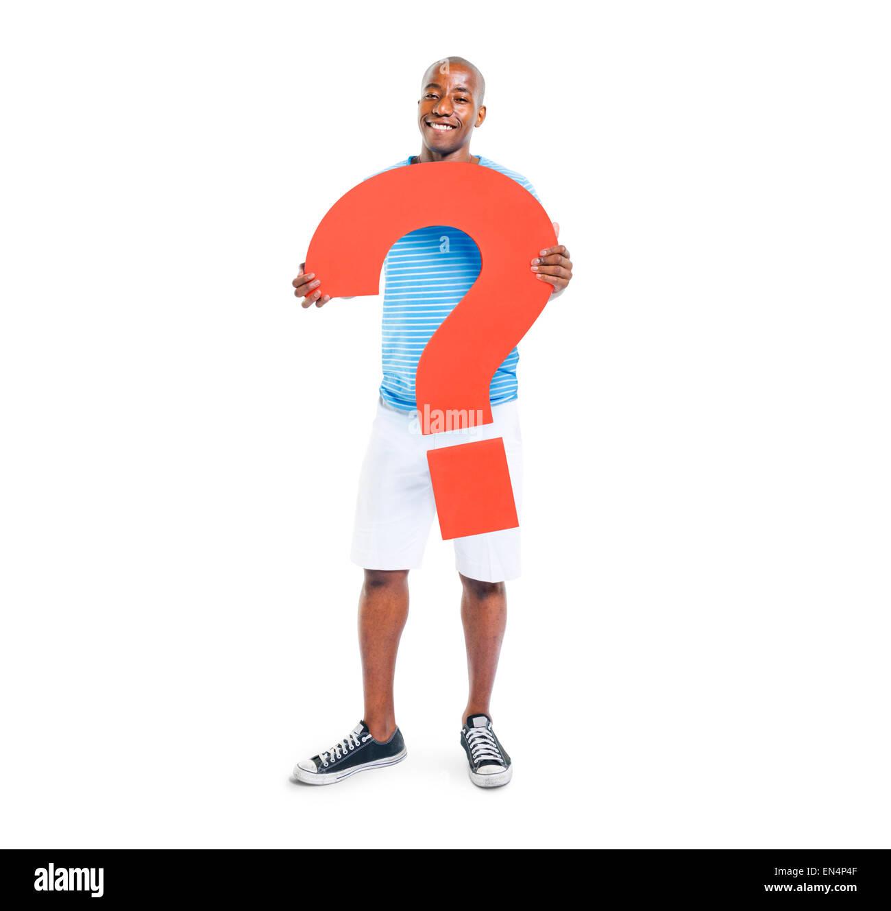 Man Holding Question Mark Symbol - Stock Image