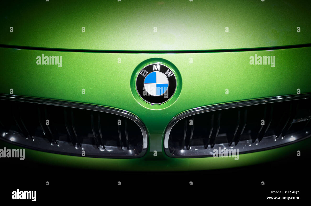 BMW logo emblem on a green car. Shot taken on a car exhibition. Editorial use only Stock Photo