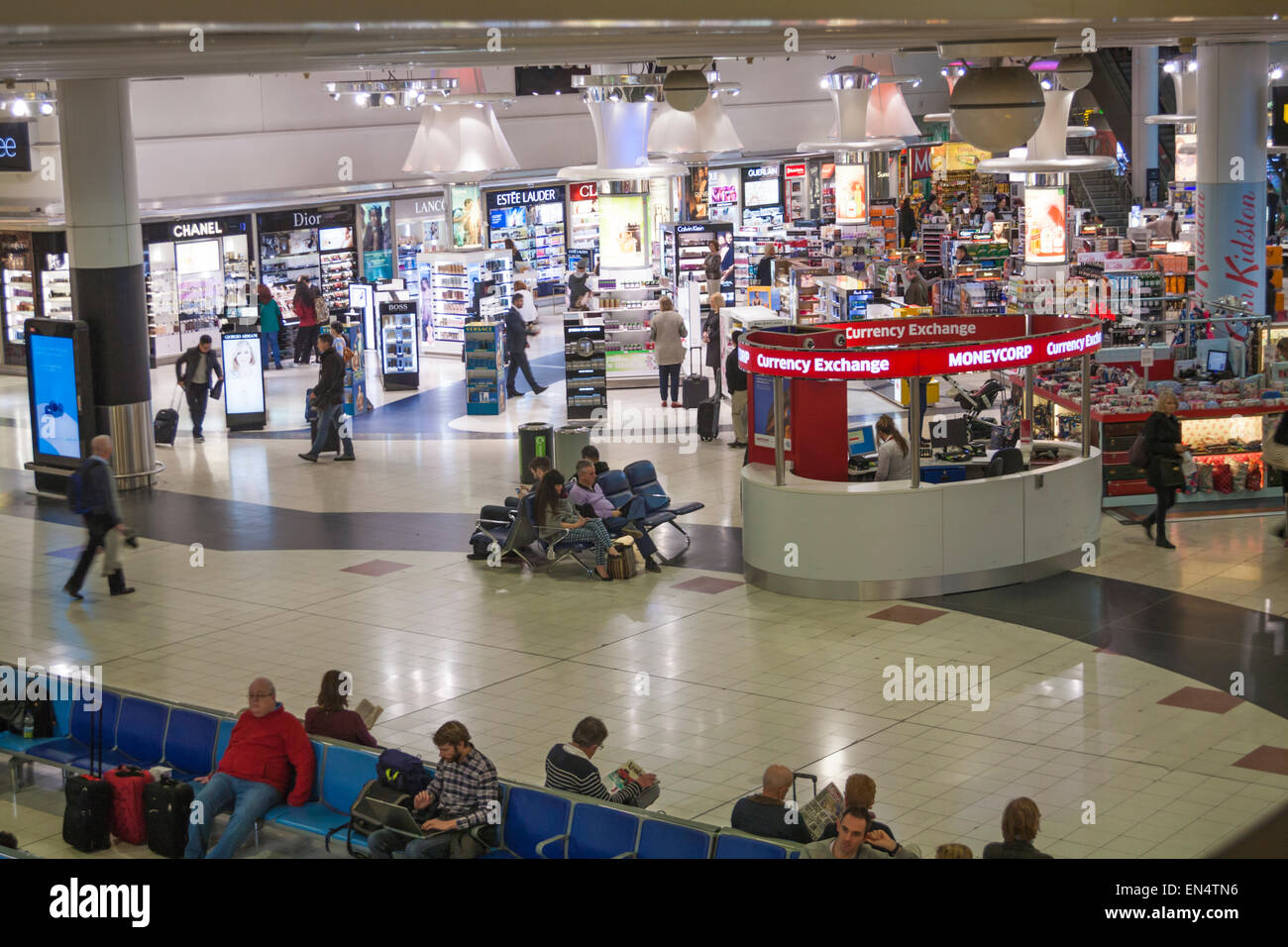 Passengers at London Gatwick Airport North Terminal, West Sussex in February - Stock Image