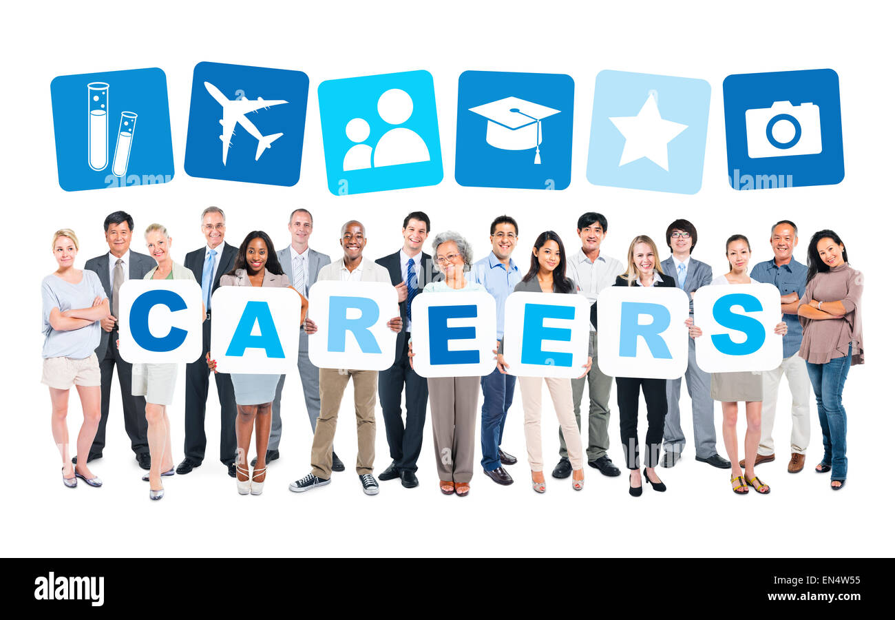 Multi-Ethnic Group Of Business People Holding Placards That Form Careers And Related Symbols Above - Stock Image