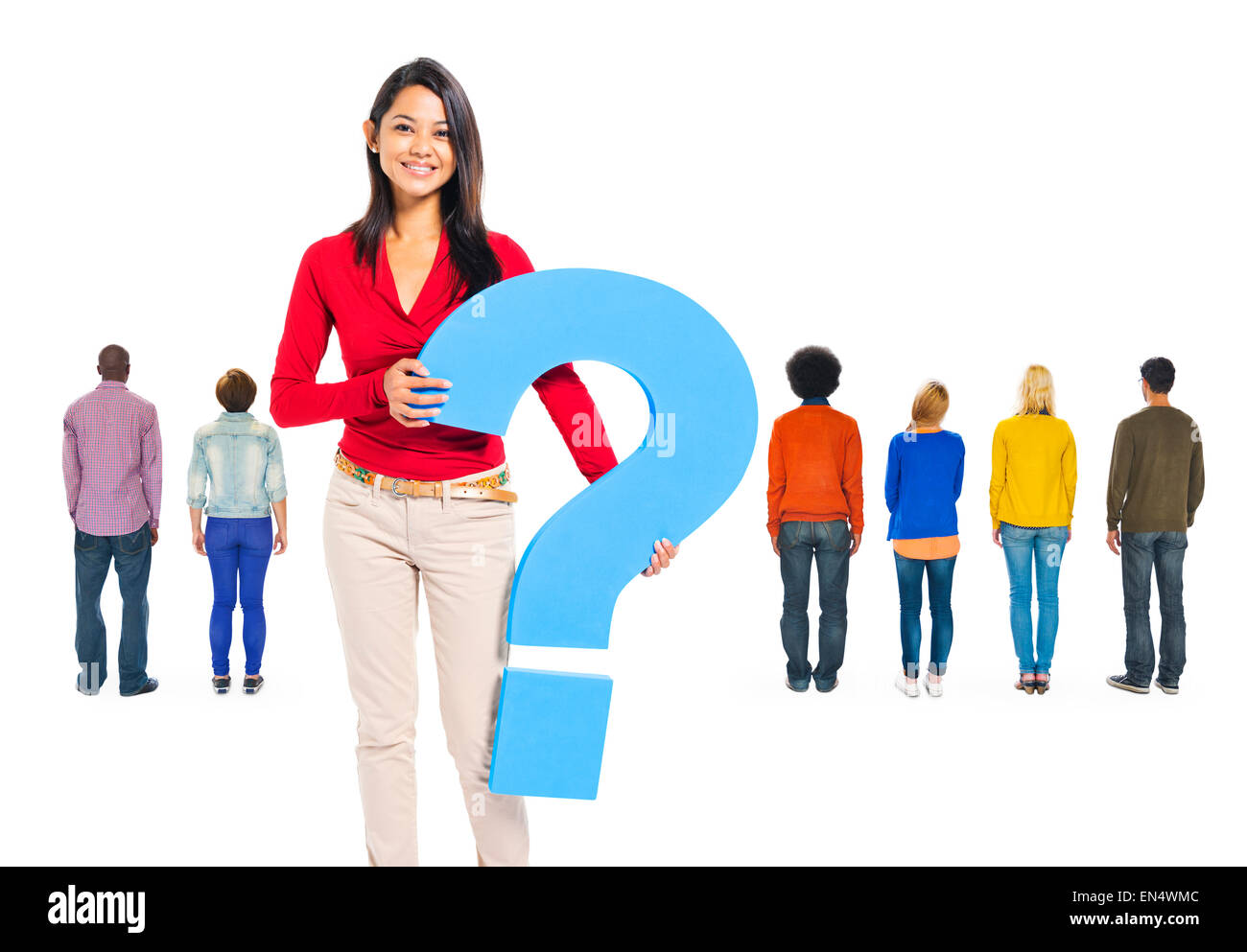 Back View Of multi-Ethnic People And A Young Woman Holding Question Mark - Stock Image