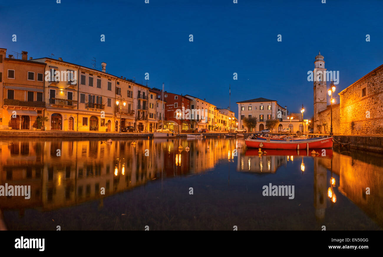 Panoramic view Port of Lazise on the lake Garda in Norther Italy. Low angle view of the port. Blue hour shot. - Stock Image