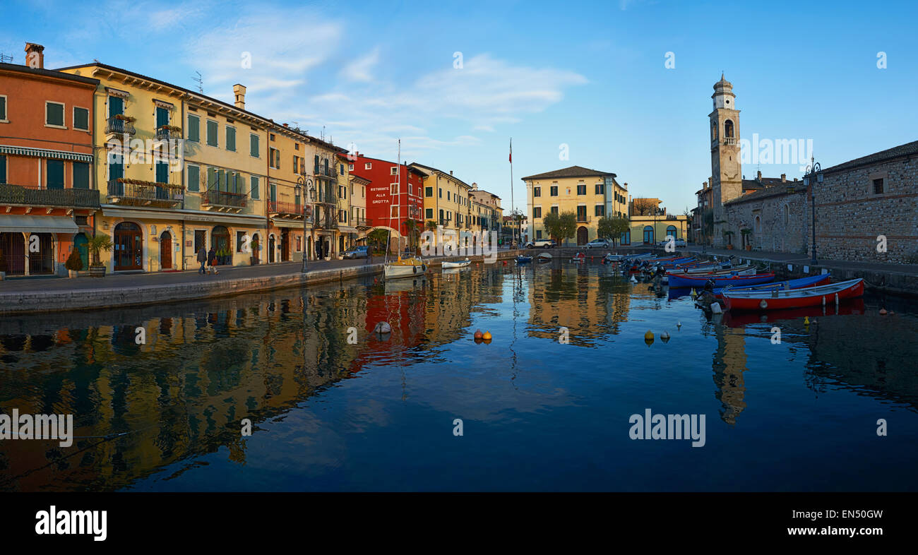 Panoramic view Port of Lazise on the lake Garda in Norther Italy. Low angle view of the port. Evening shot. calm - Stock Image