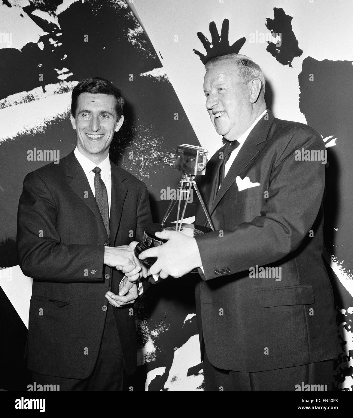 English cyclist Tommy Simpson receives the 1965 Sports Personality of the Year trophy from Sir Stanley Rous at the - Stock Image