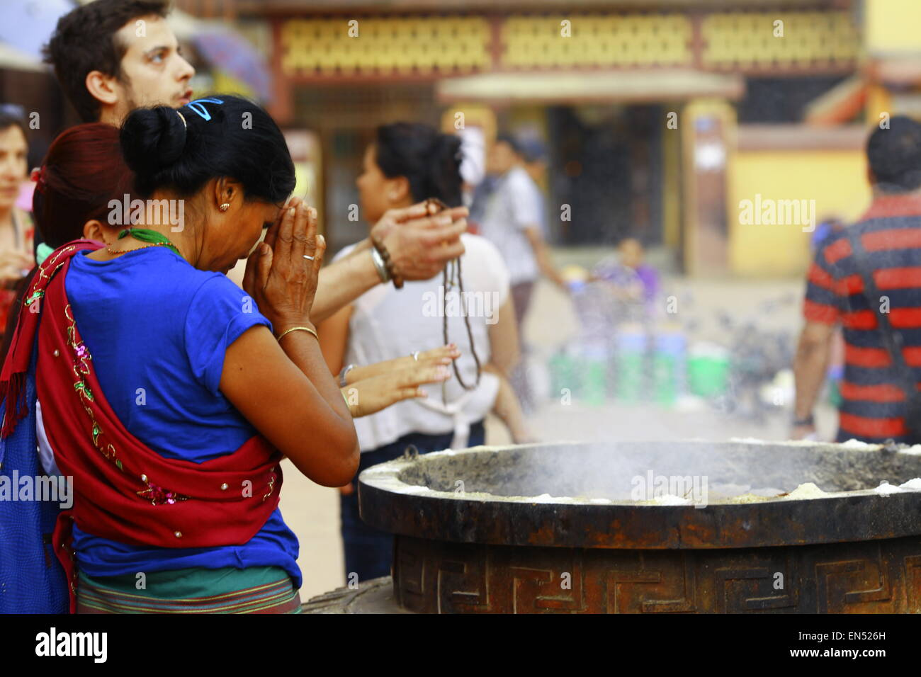 people praying in holly temple Boudanath in Nepal - Stock Image