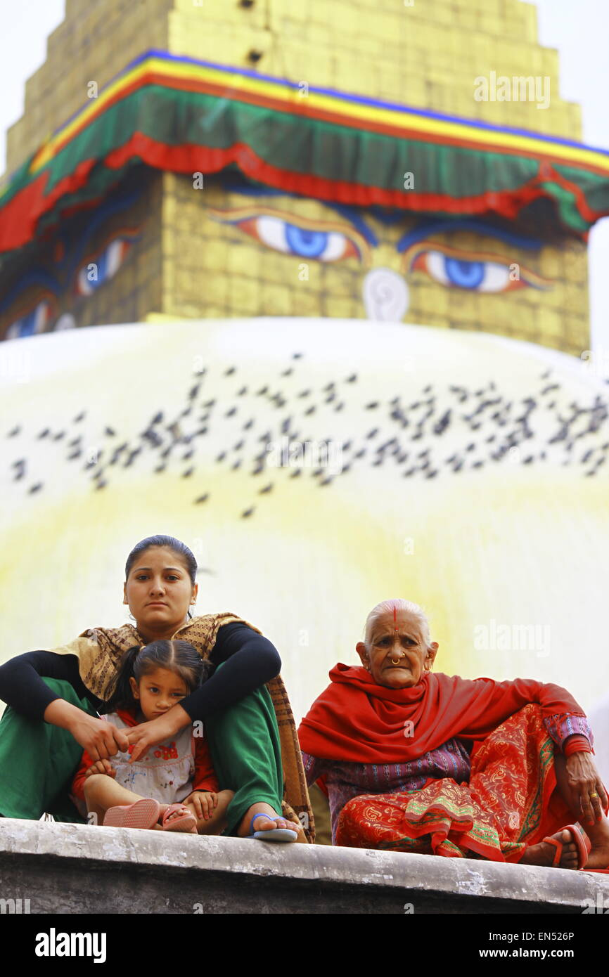 three generation of nepalese women in holly place in Kathmandu, Boudhanath stupa - Stock Image
