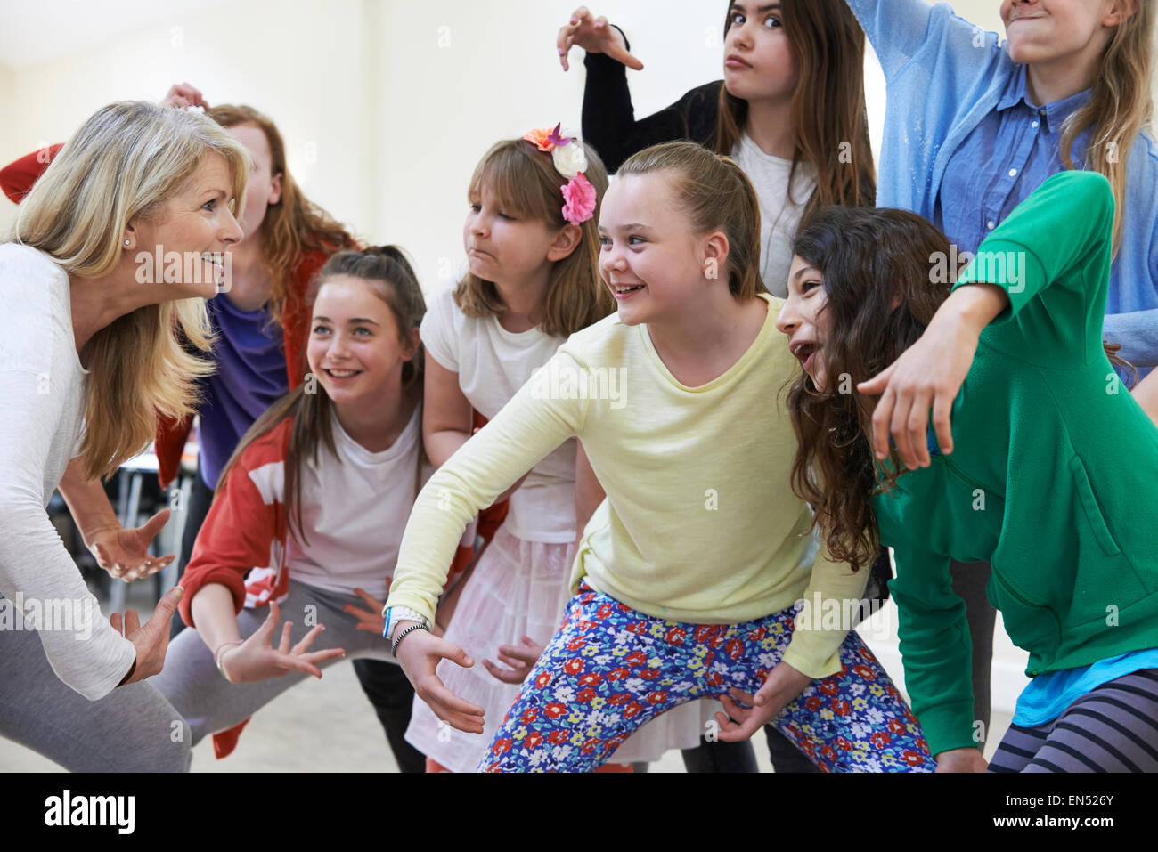 Group Of Children With Teacher Enjoying Drama Class Together - Stock Image