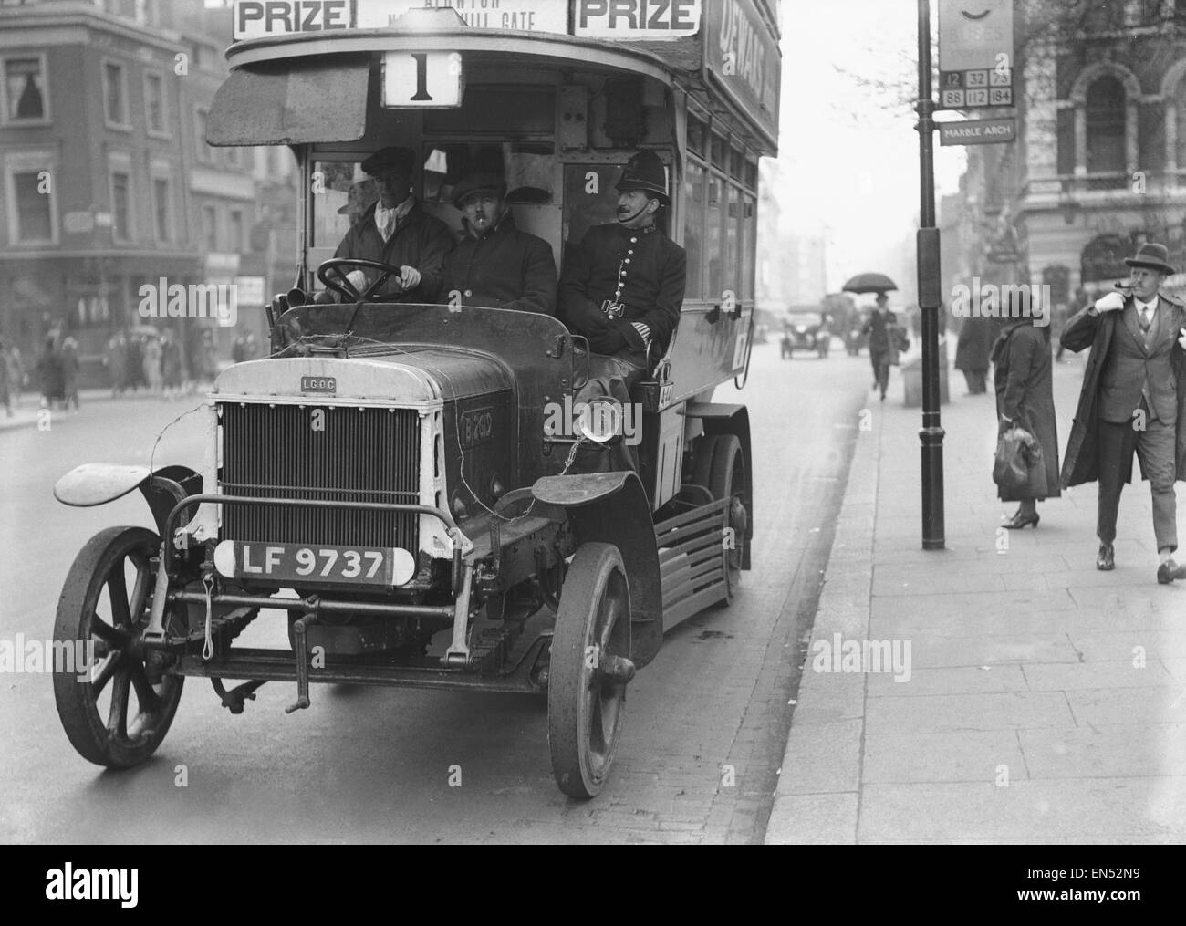 Bus driven by a volunteer seen here during the 10th day of the General Strike. The policeman and the barbed wire - Stock Image