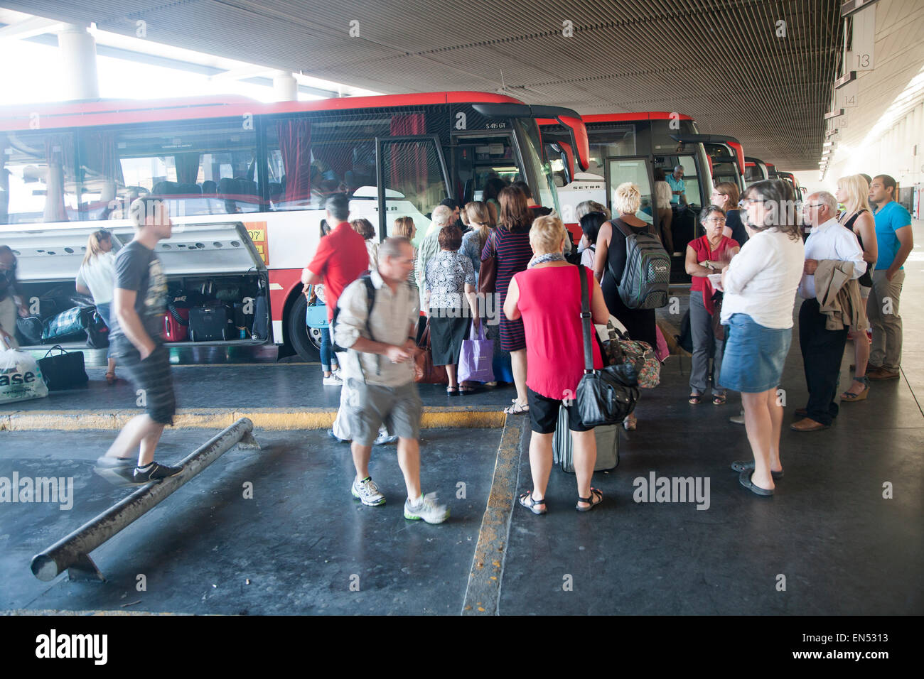 Passengers boarding long distance coach at Granada bus station, Spain - Stock Image