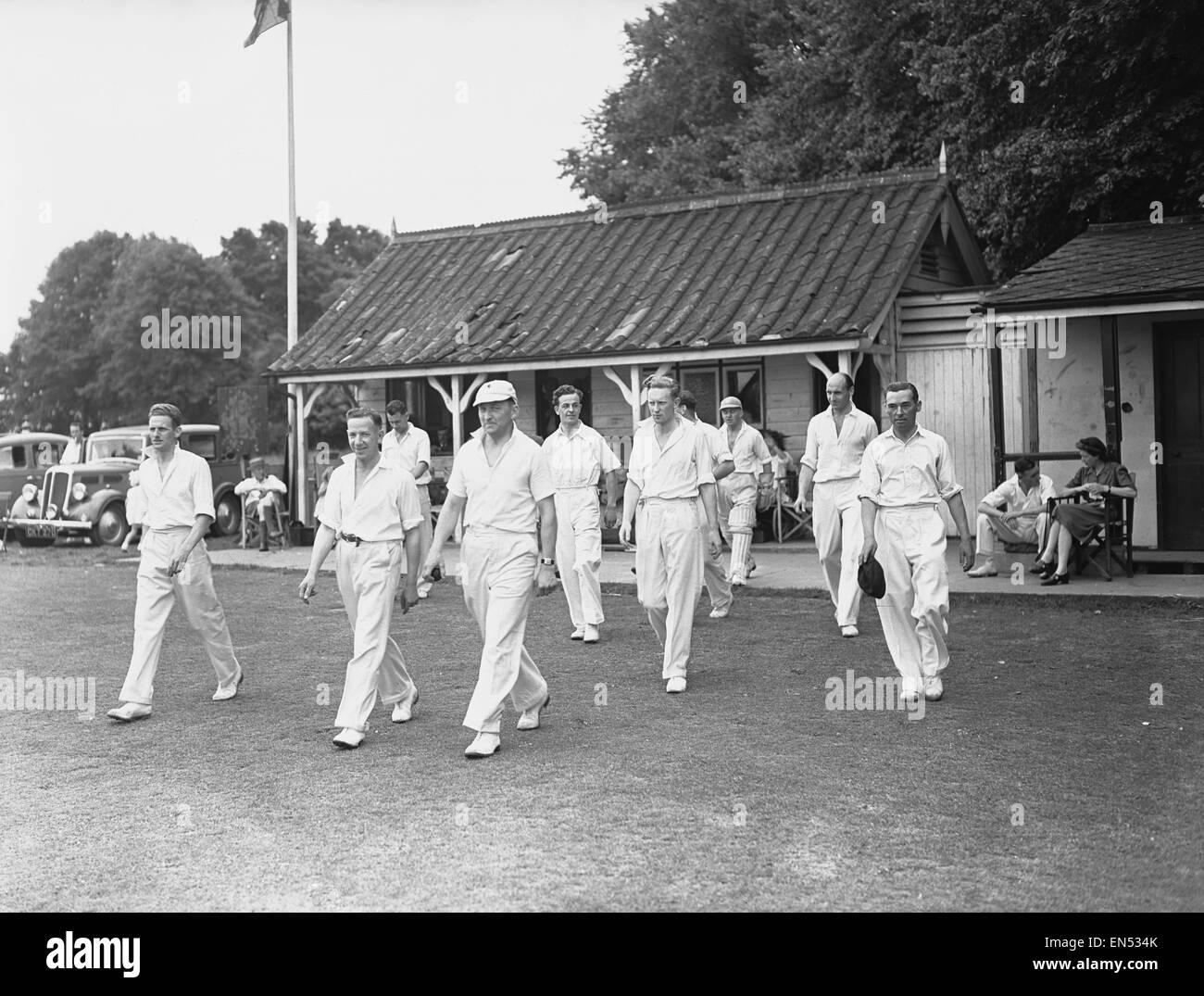 The local cricket team at Meopham one of the oldest teams in Kent seen taking to the field Circa June 1950 Stock Photo