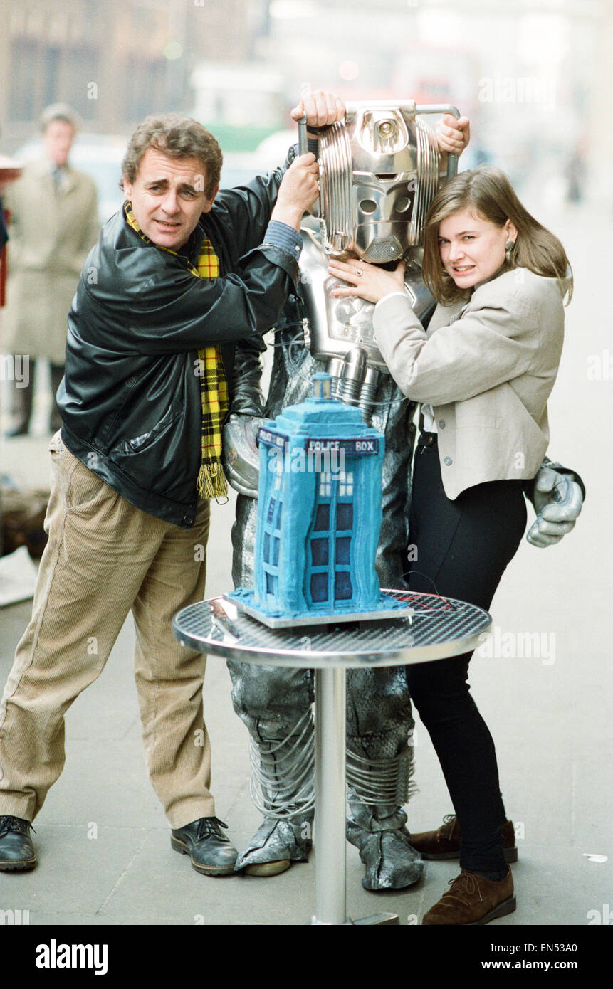 Dr Who, Sylvester McCoy with his assistant Ace alias Sophie Aldred seen here with a cyberman cutting a cake in the - Stock Image