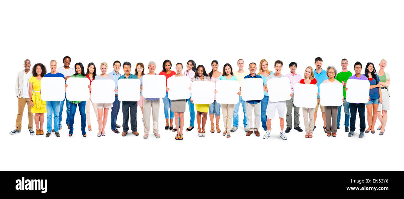 Group Of People Holding A Blank Board - Stock Image