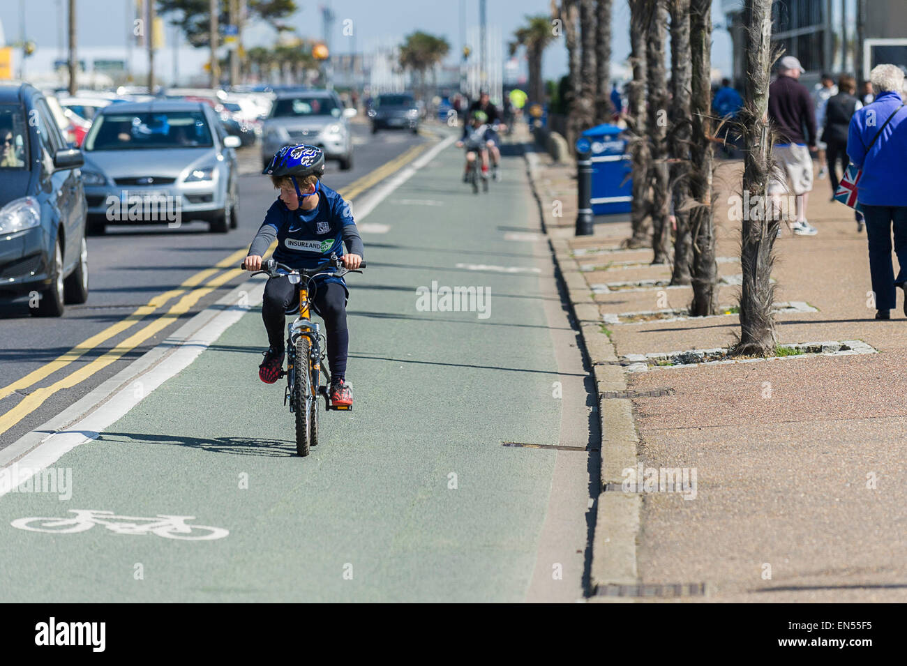 A young cyclist using the cycle lane on the seafront in Southend. - Stock Image