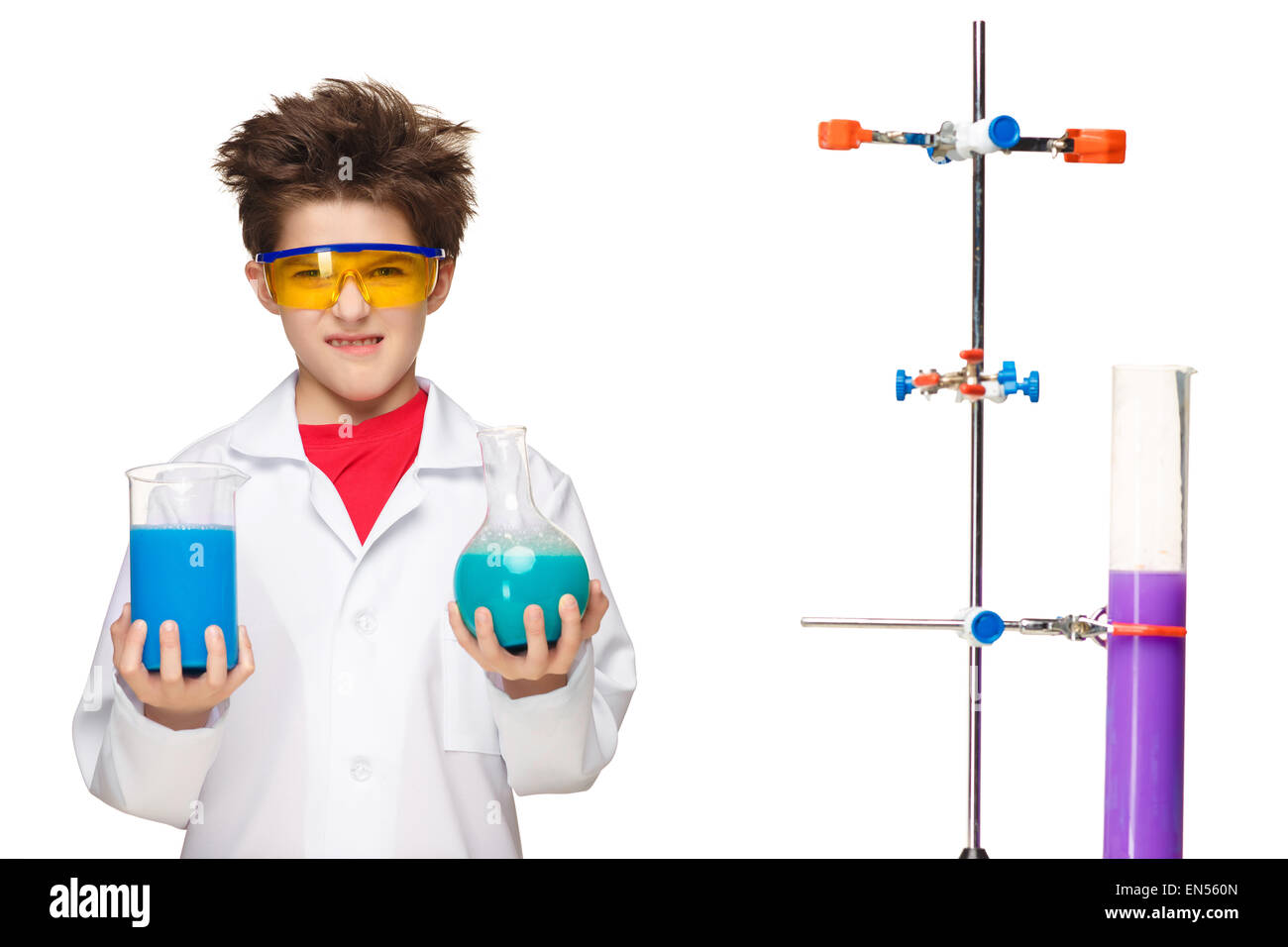 Little boy as chemist doing experiment with chemical fluid in the laboratory - Stock Image