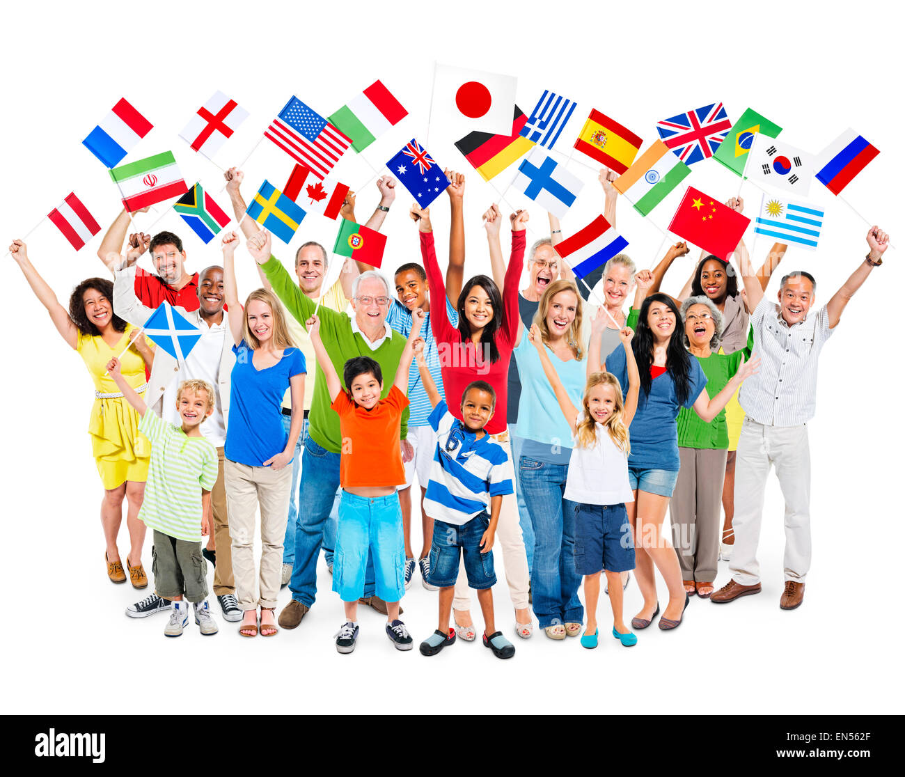 Large group of multi-ethnic diverse mixed age people celebrating while holding flags. - Stock Image