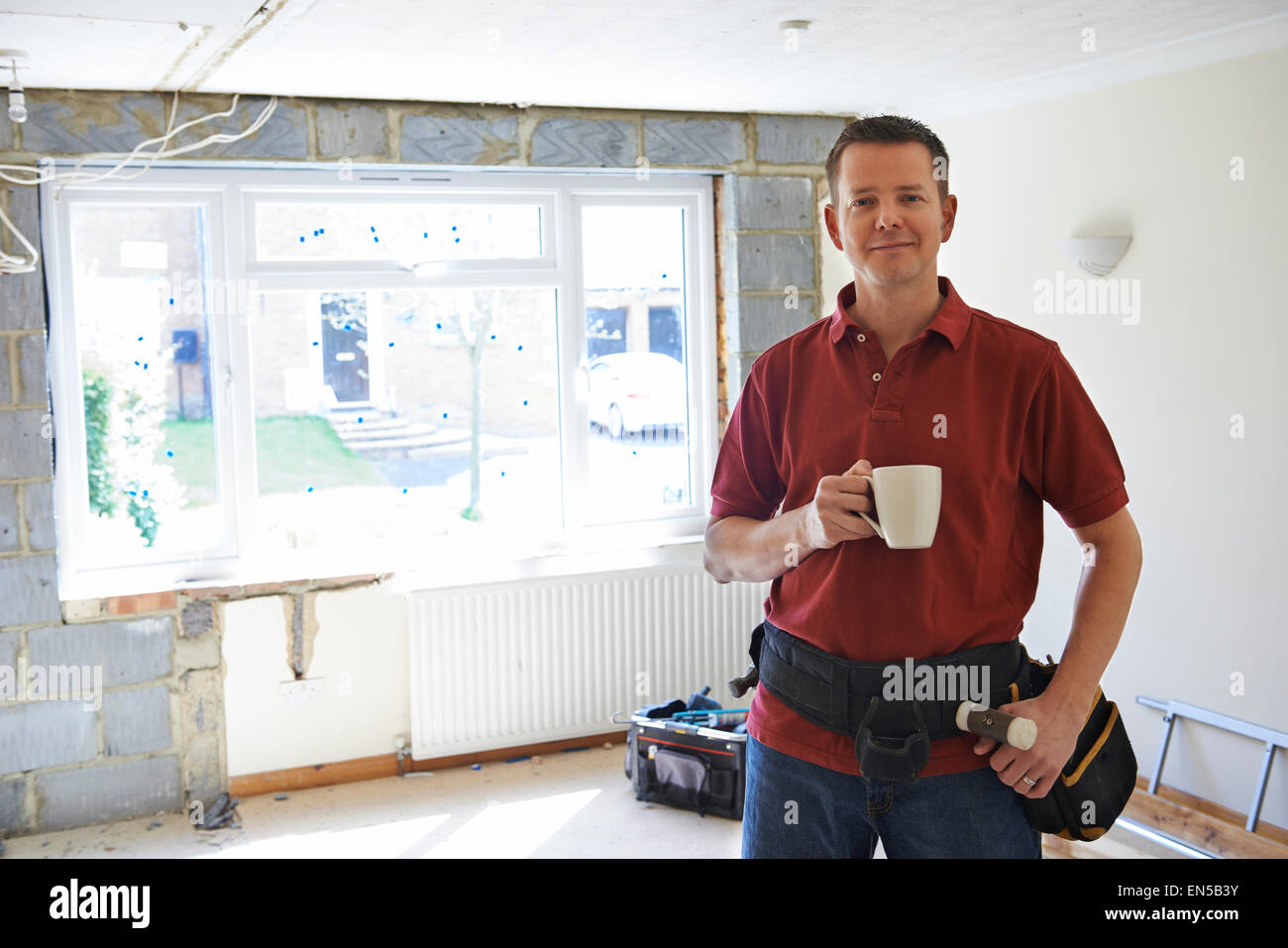 Builder Carrying Out Home Improvements Taking A Break - Stock Image