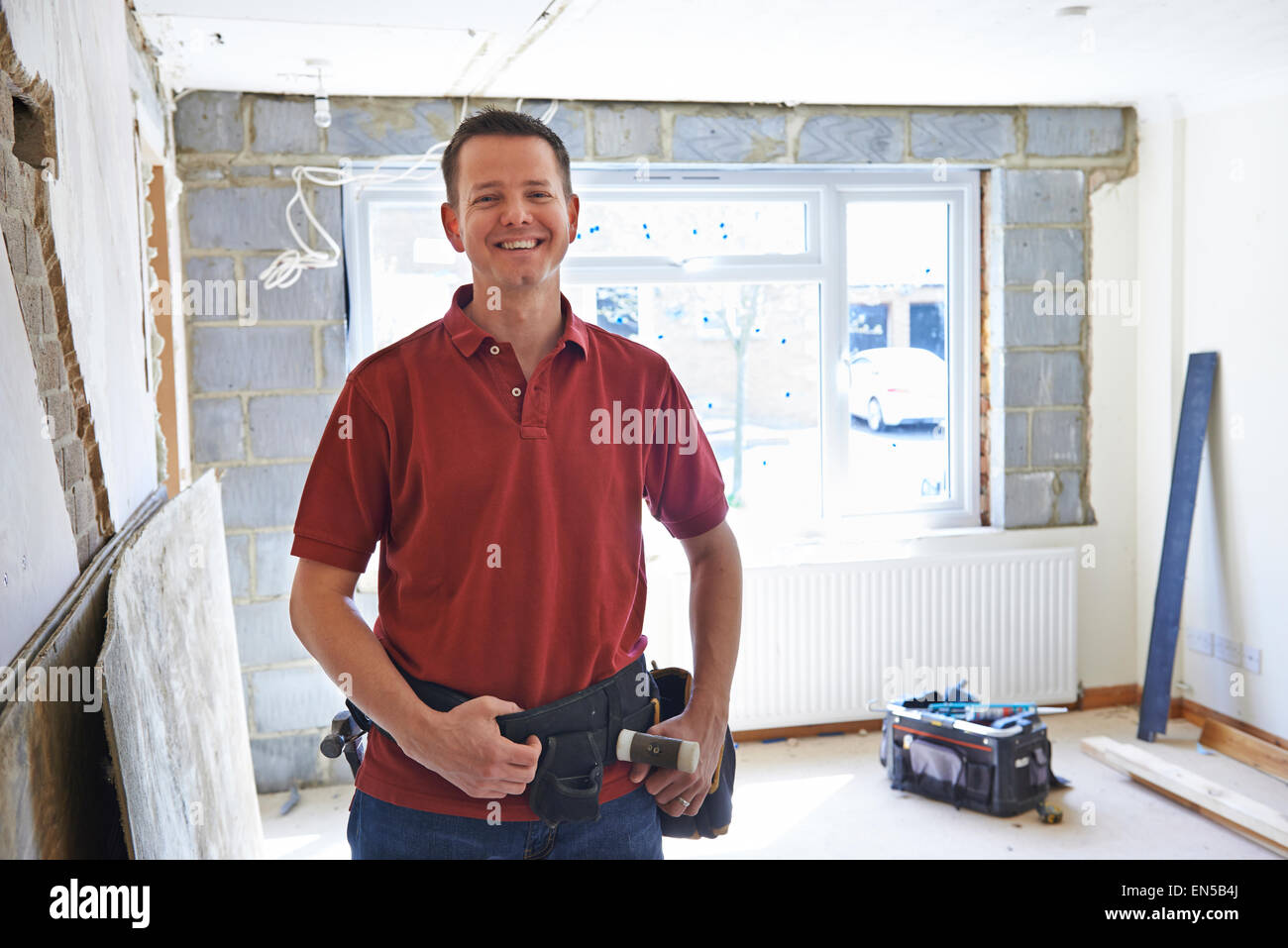 Portrait Of Builder Carrying Out Home Improvements - Stock Image