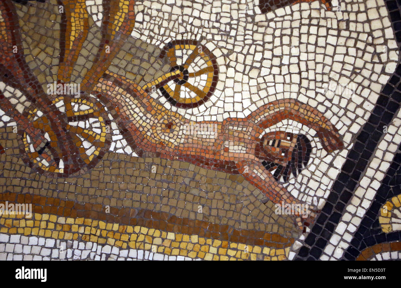 Roman Art. Trojan War. Mosaic. Achilles in his chariot dragging the corpse of Hector. Detail Hector. From Vigna Stock Photo