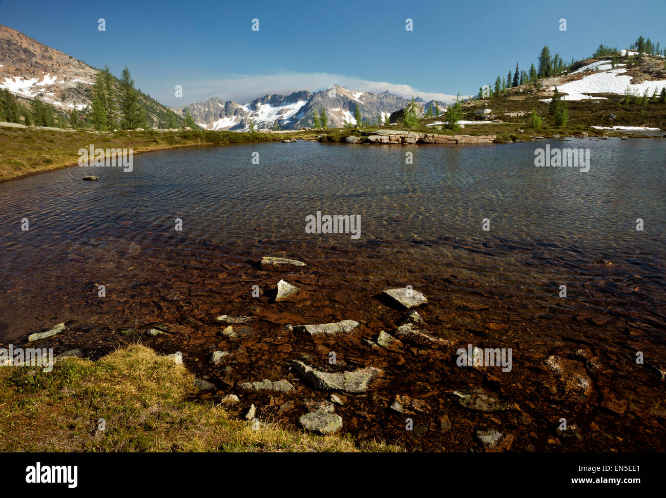 WASHINGTON - Smoke from several forest fires blowing up over a ridge south of Upper Snowy Lake in the North Cascades. - Stock Image