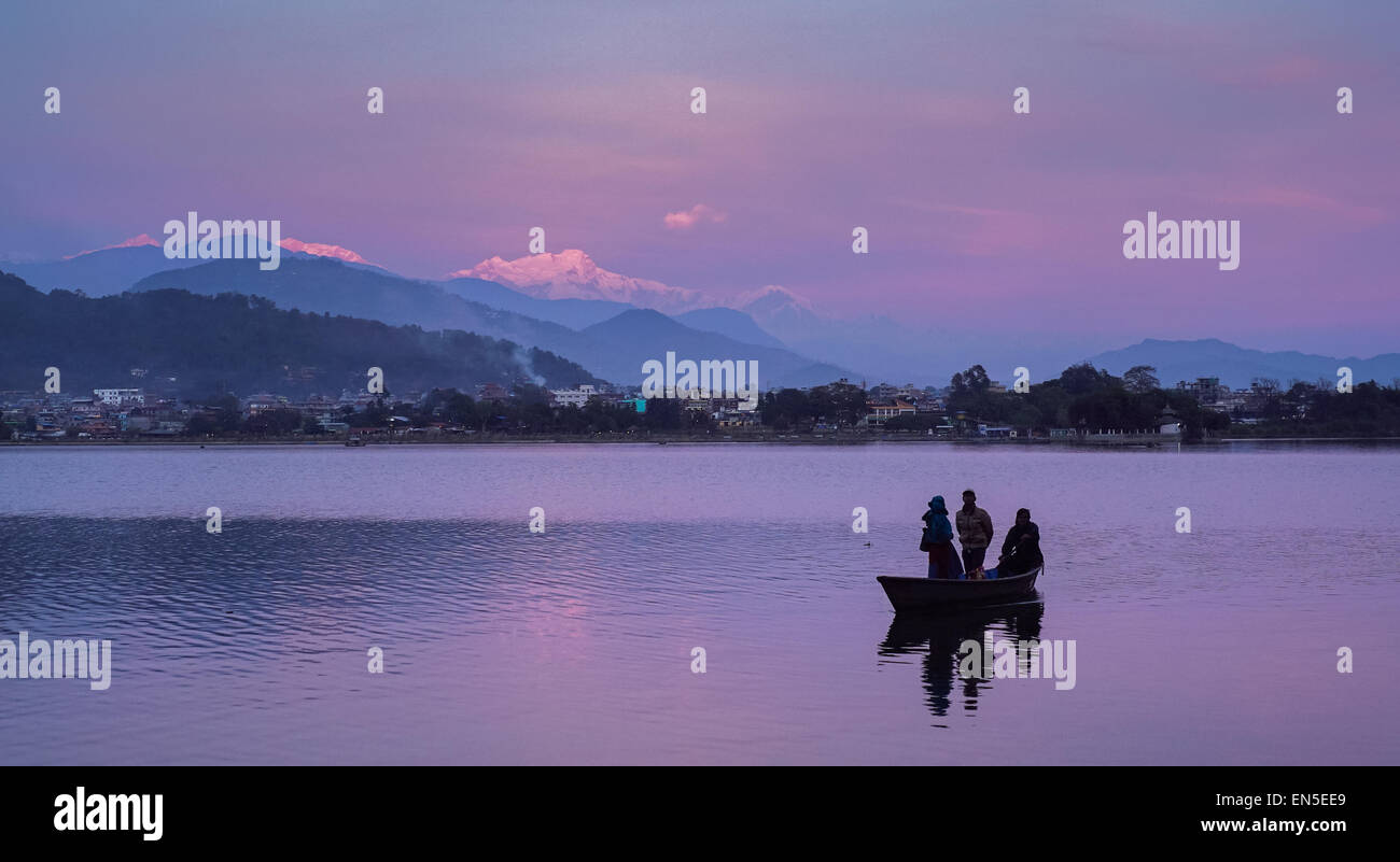 Phewa lake in Pokhara, Nepal with the city and Annapurna range of the Himalayas in the background - Stock Image